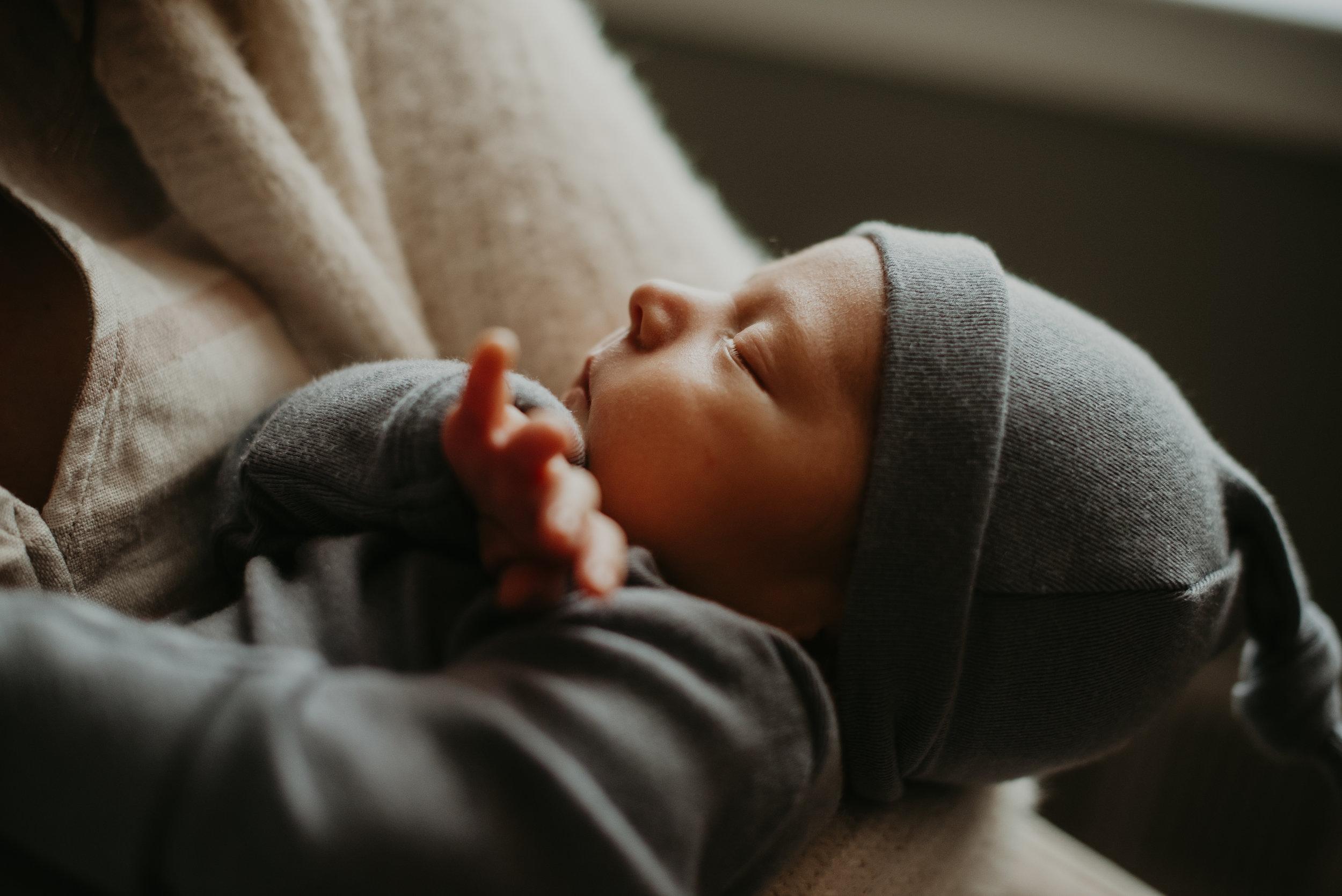side profile of newborn baby boy in home session atatlanta