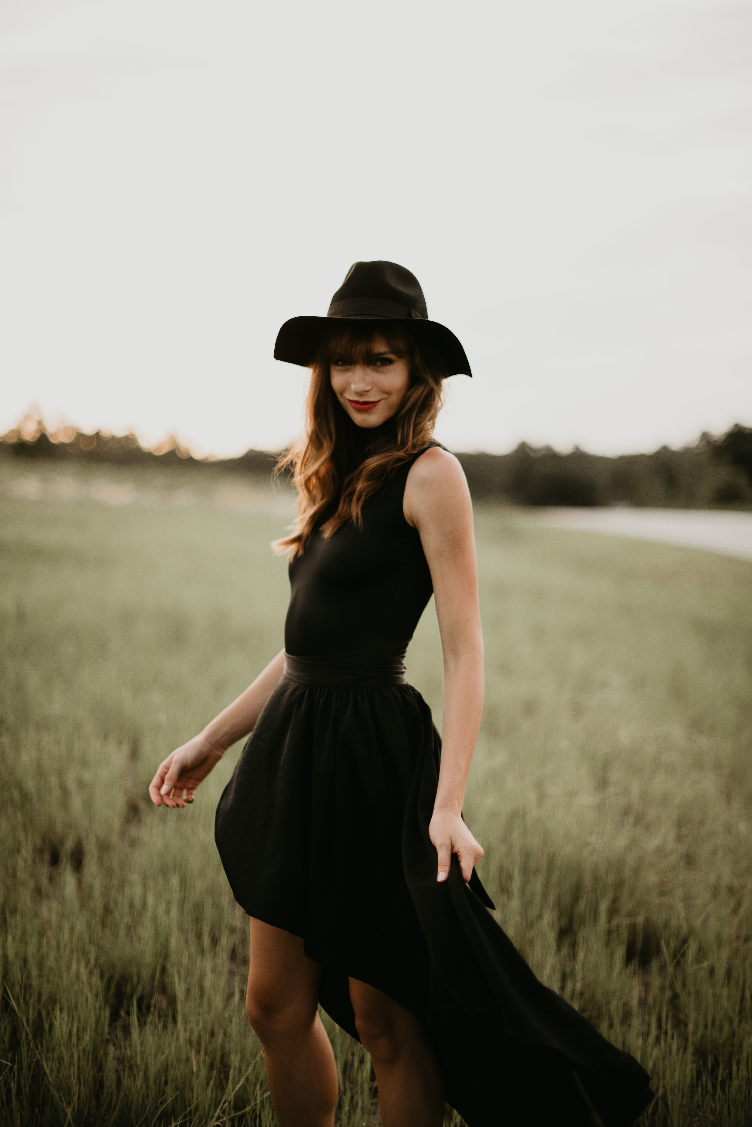 fashion model amy heim poses in black dress orlando session