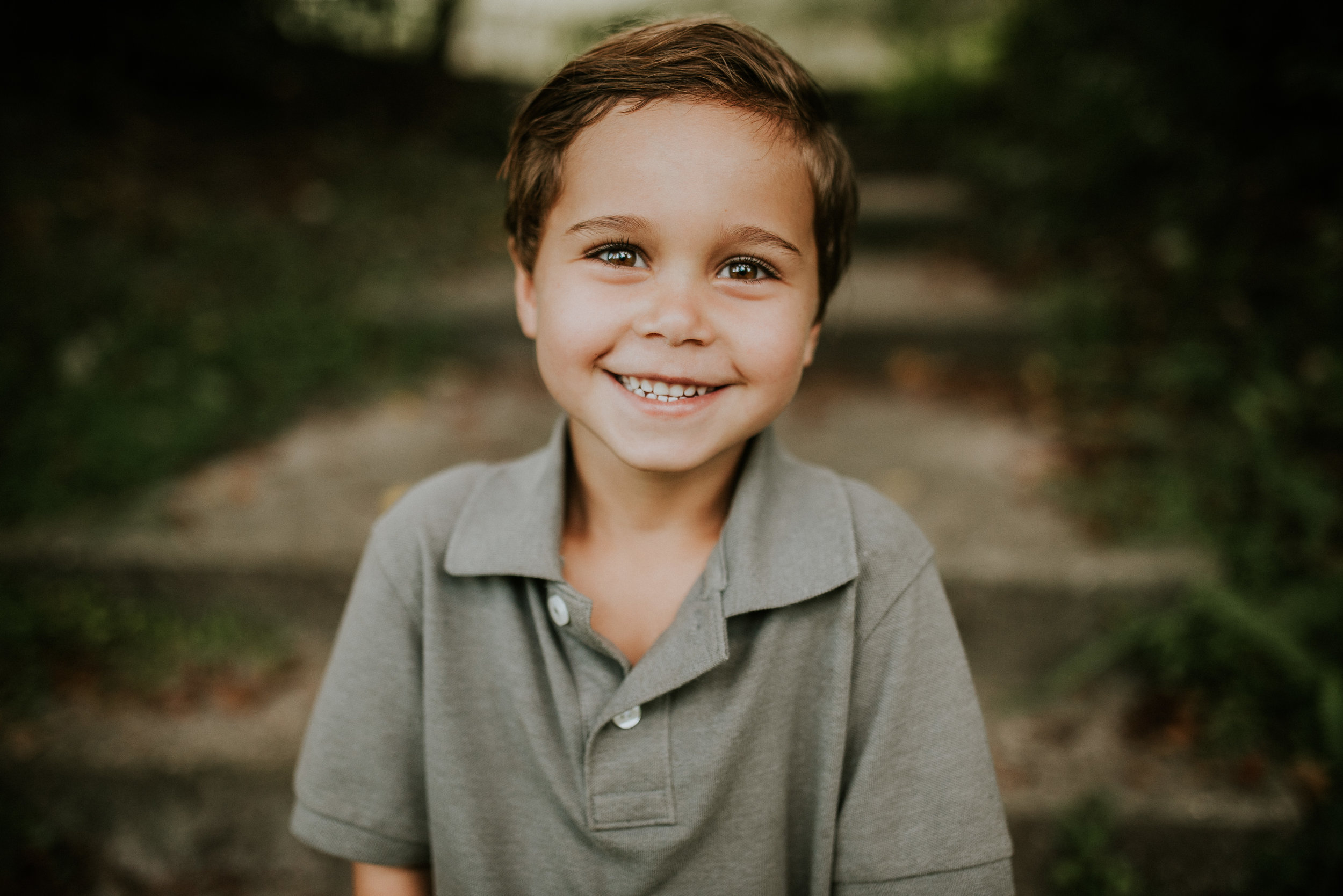 portrait of young boy at family photo session in mead botanical garden orlando