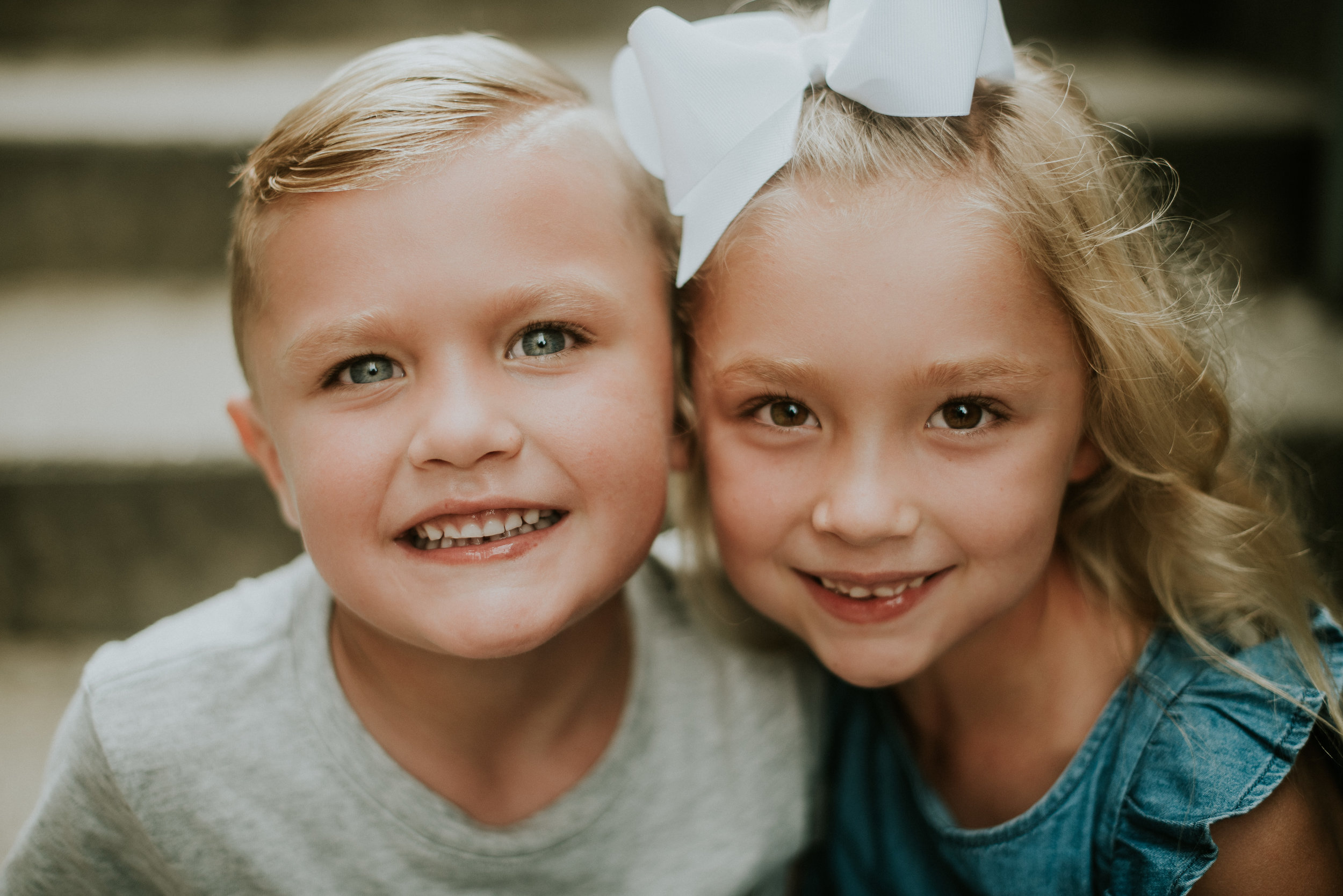 Son and daughter close up portrait at family photo session marietta square