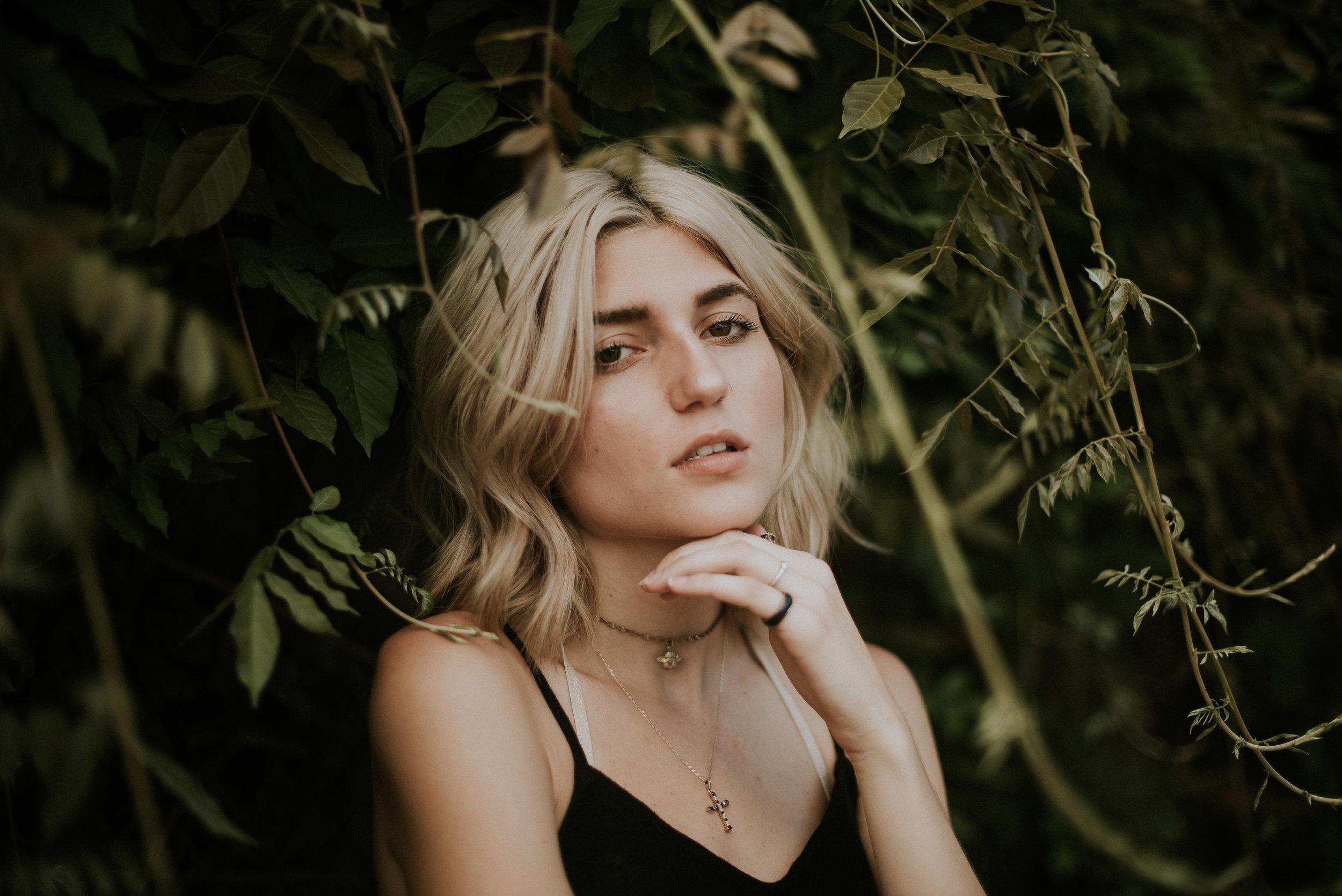 fashion model posing in greenery at atlanta styled shoot on krog street