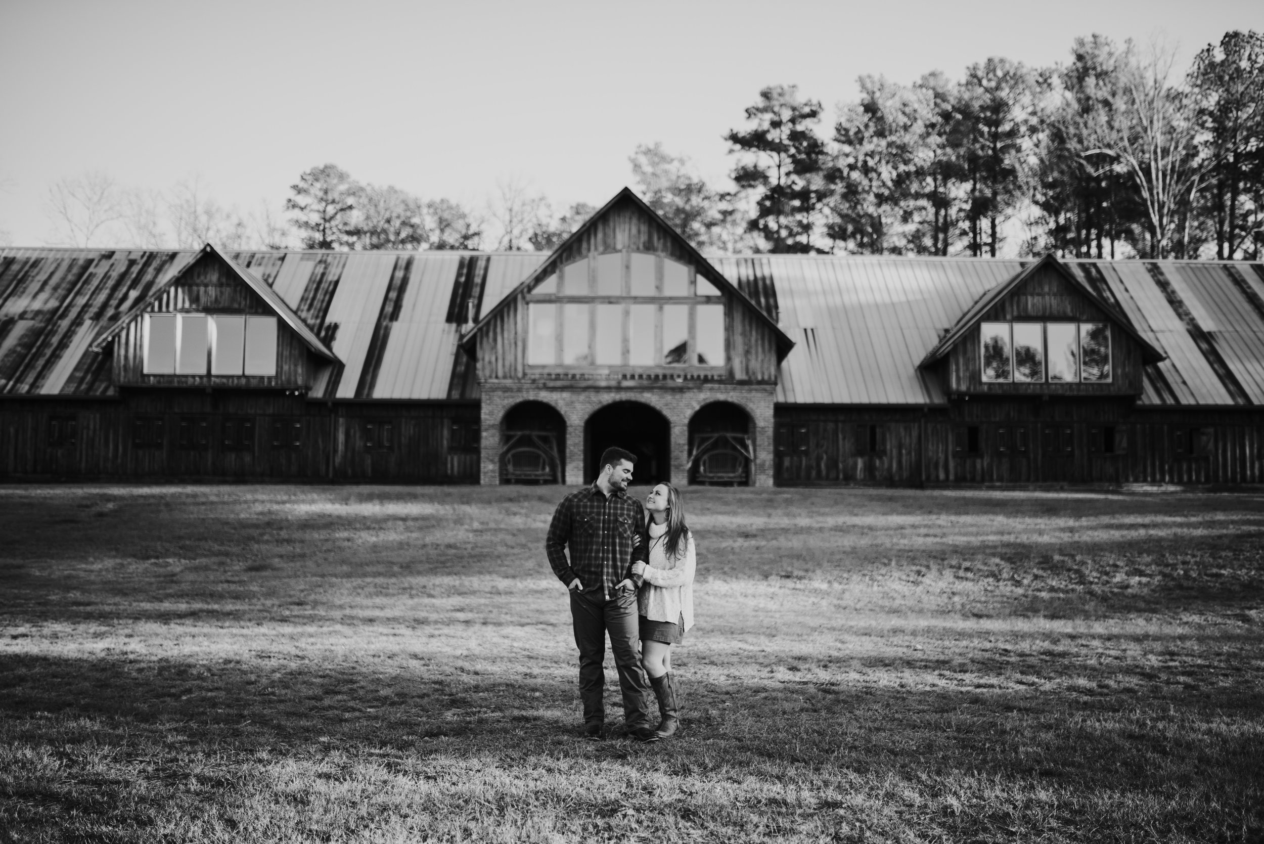 Wide shot of couple standing together at the farm in rome georgia