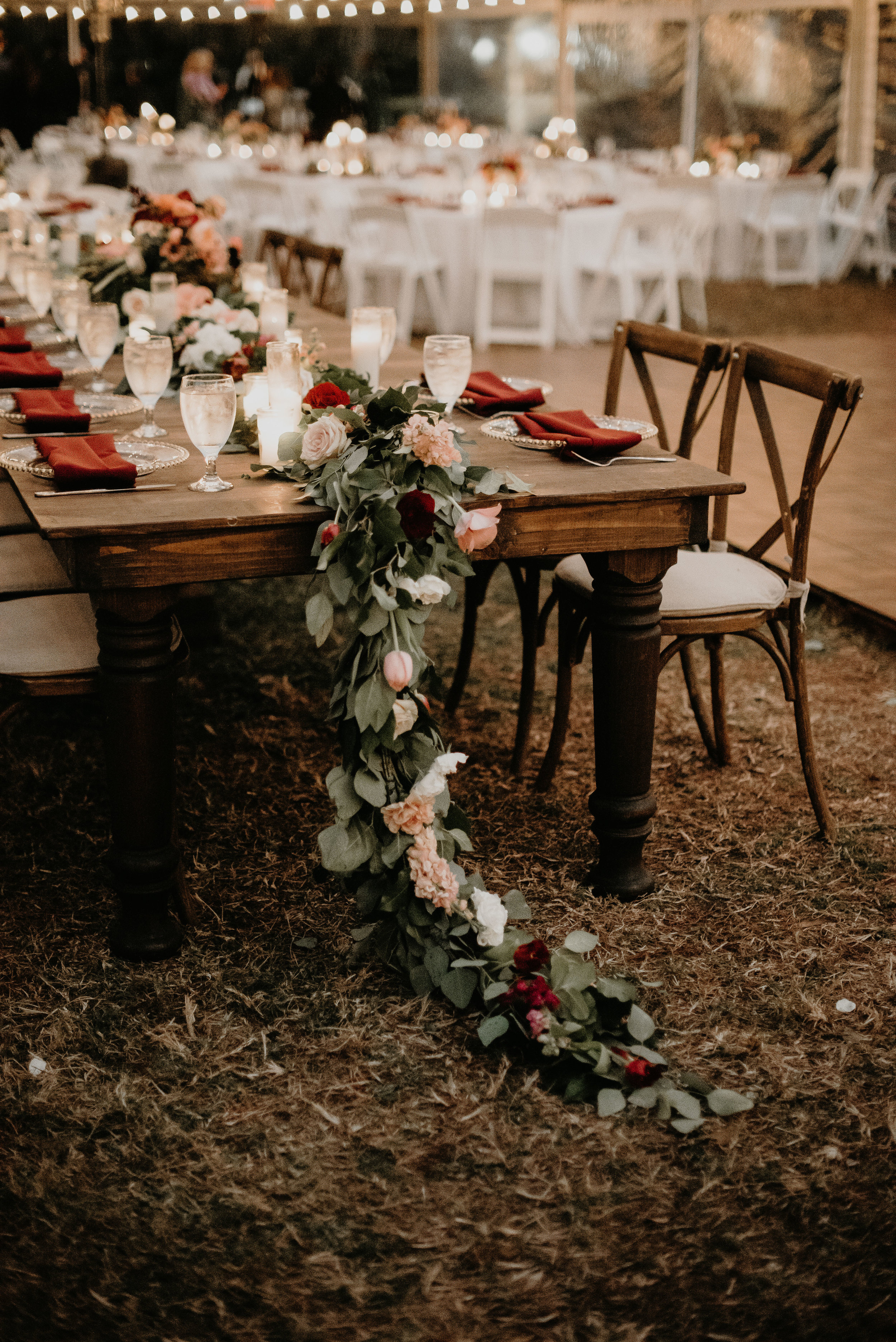 Floral table runner by Velvet and Twine at Cypress Grove Estate House tent reception