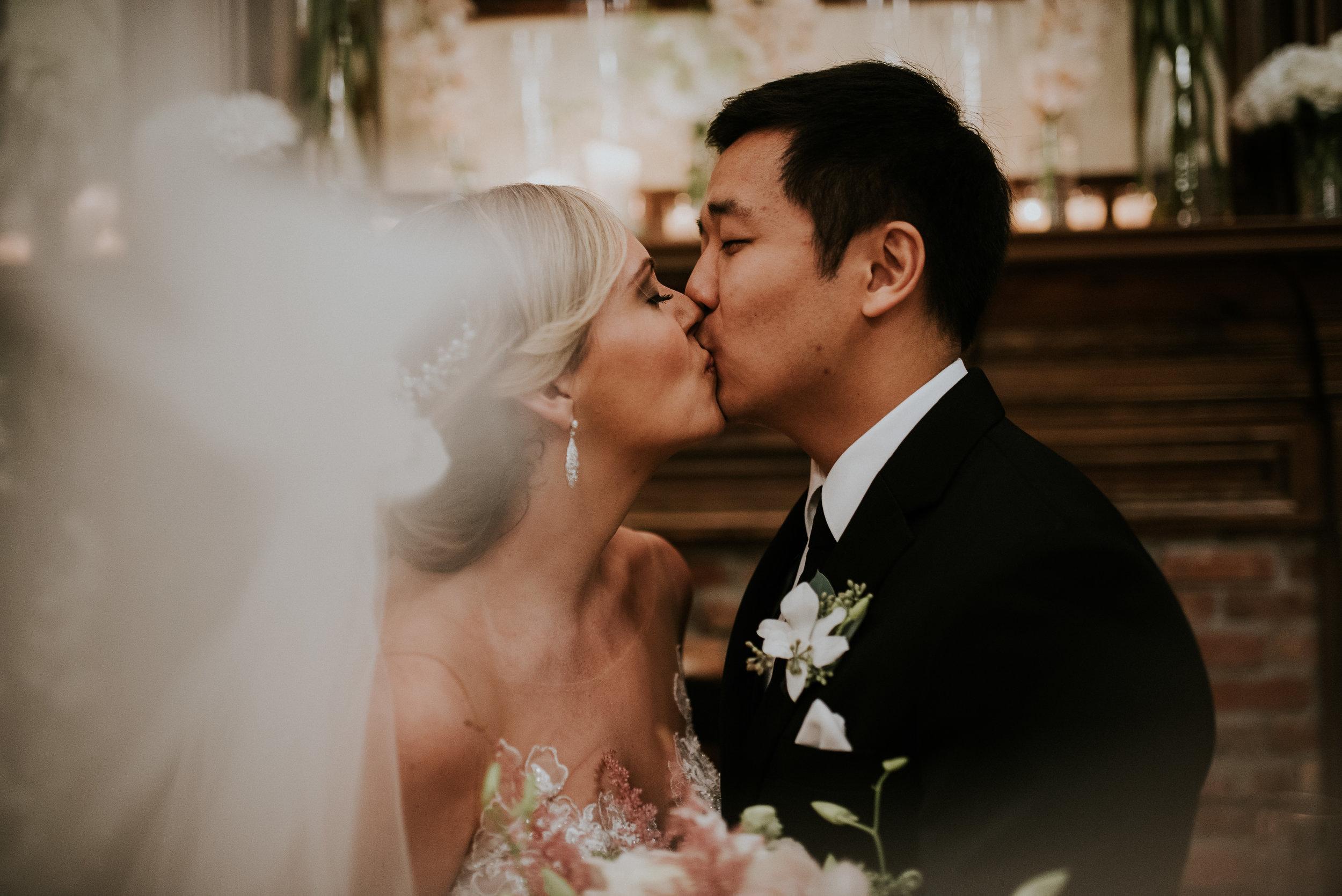 Bride and groom kissing through the veil at The Carl House in Auburn, GA