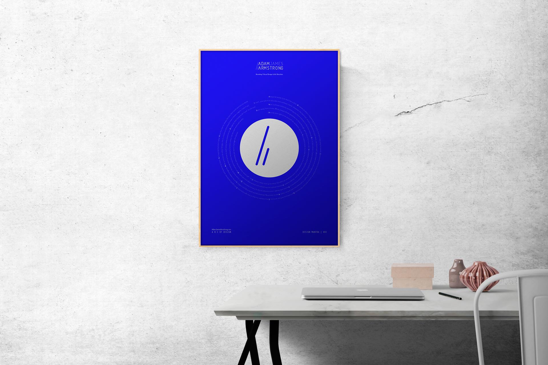 My free design mantra poster framed above a desk