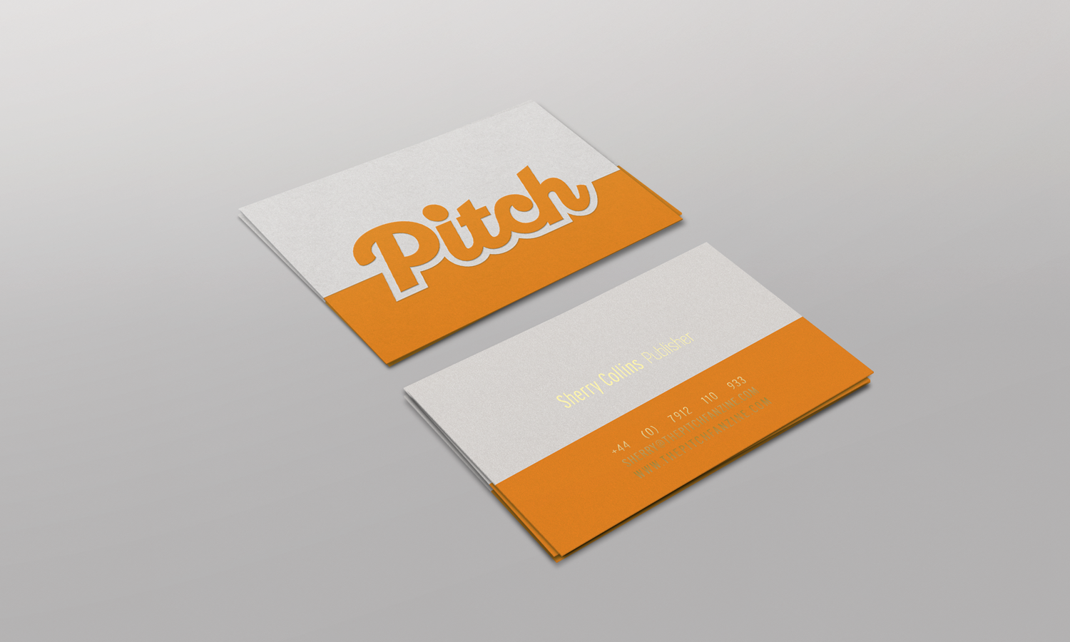 Pitch business card in orange and gold foil.
