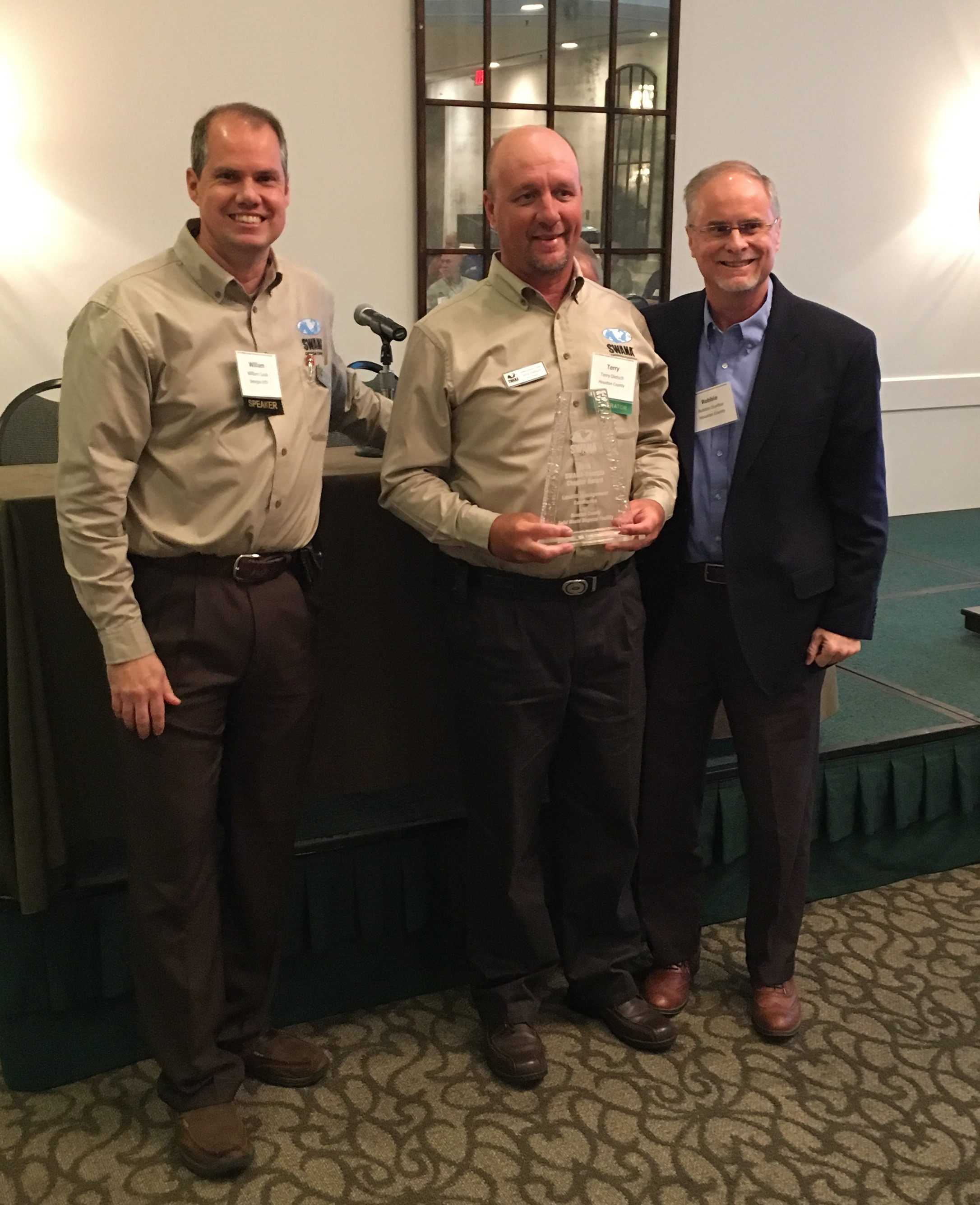 Mr. Robbie Dunbar and Mr. Terry Dietsch of Houston County and Mr. William Cook of Georgia EPD Solid Waste Program were at the SWANA-Georgia Fall Conference Opening Luncheon at Sea Palms Resort on St. Simons Island to receive the award.