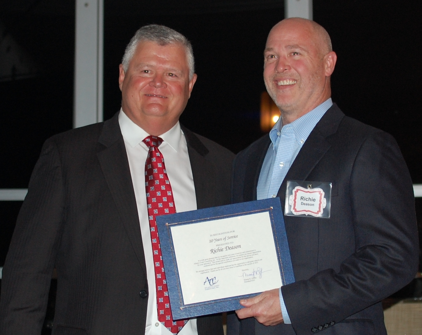 CEO Murray K. Griffin presents  COO Richard Deason a certificate recognizing ACC's 10th Anniversary..JPG
