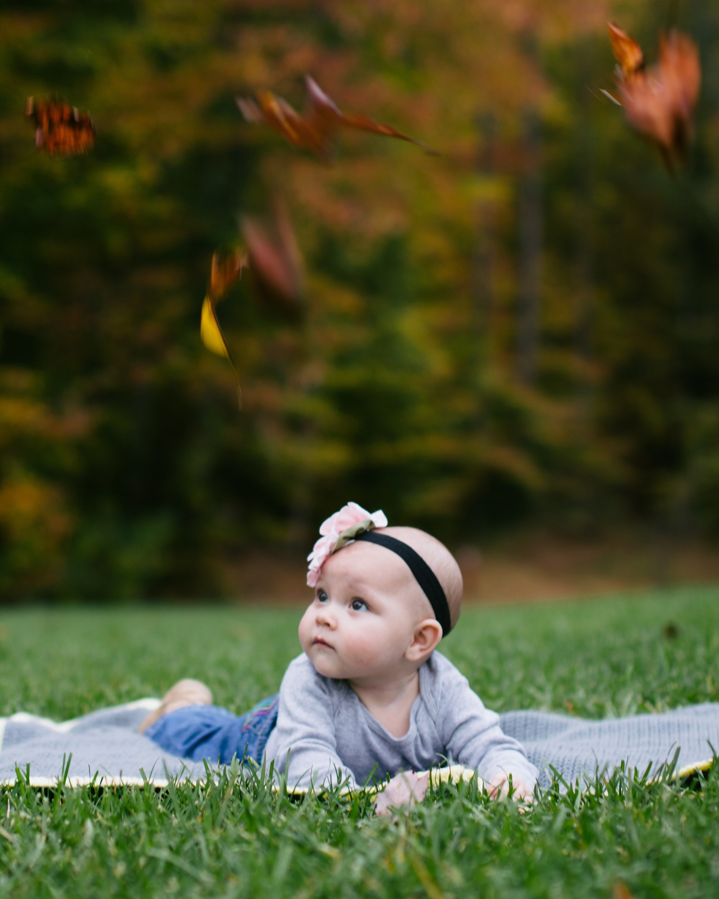 Kind of like this adorable fall photo of leaves falling on this adorable little human