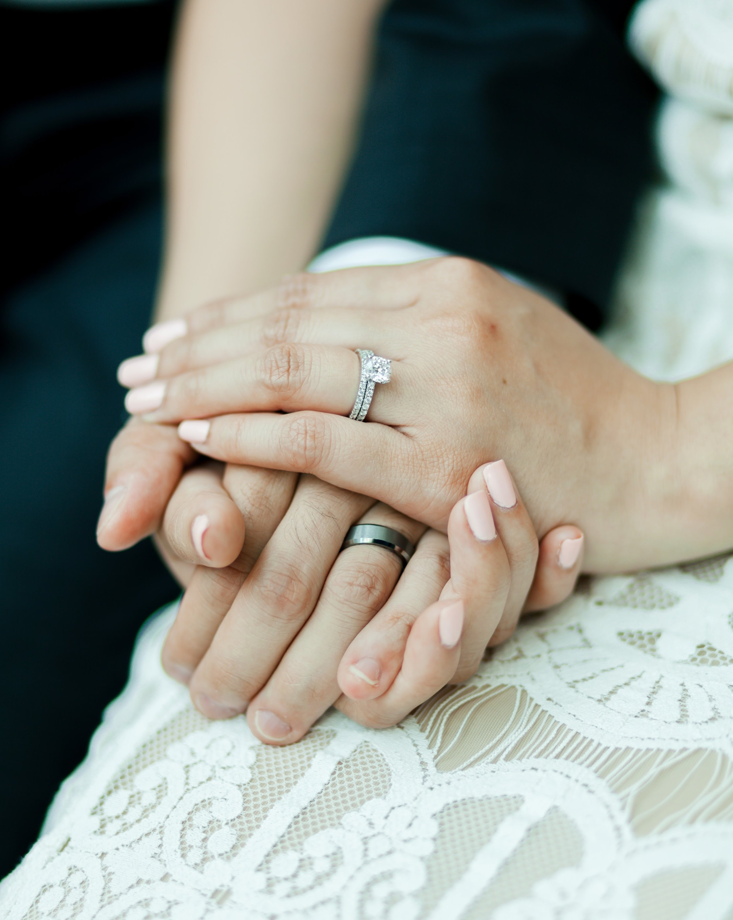 Just having a couple hold eachothers hands is a great way to display the rings.