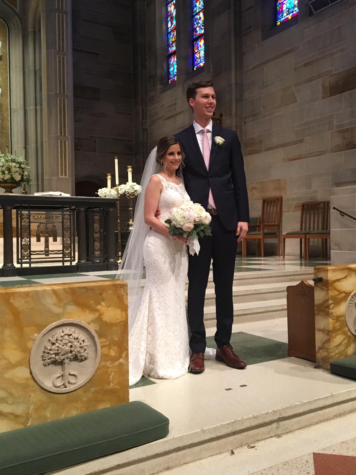 Ceremony Venue:  Cathedral of Christ the King  Bouquet & boutonniere by  On Occasions of Atlanta