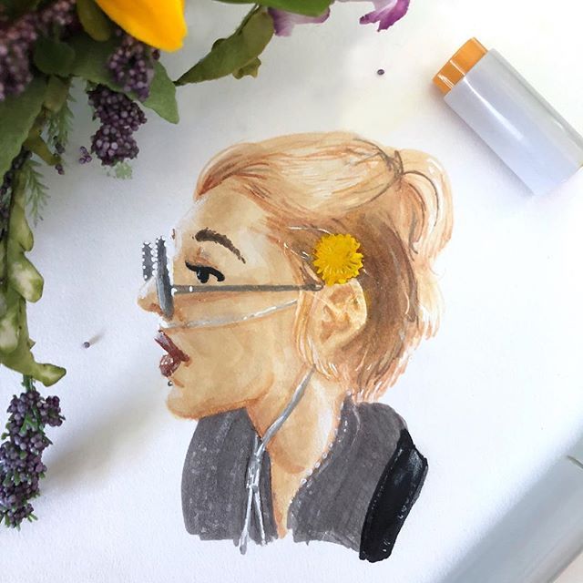 My roommate! 🌼 [ID: drawing of a pale person with strawberry blonde hair half tied back. There is a dandelion in their hair. They're wearing black sunglasses and a nasal cannula]