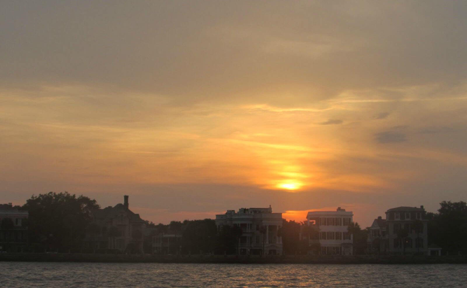 Beautiful sunset view from the harbor over the Battery in Charleston, SC
