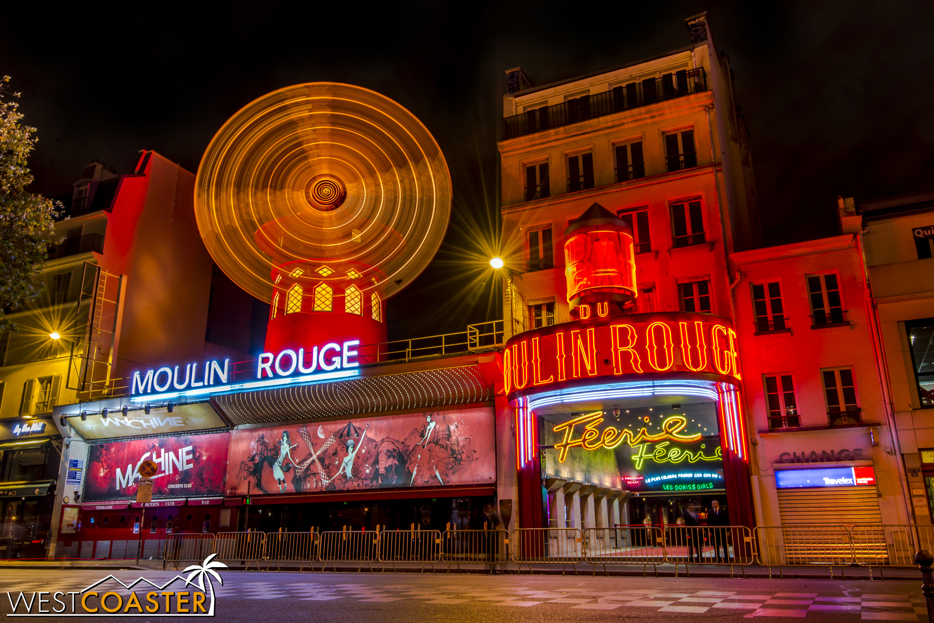 The bright lights and whirling iconic windmill of the Moulin Rouge, still operating to this day.