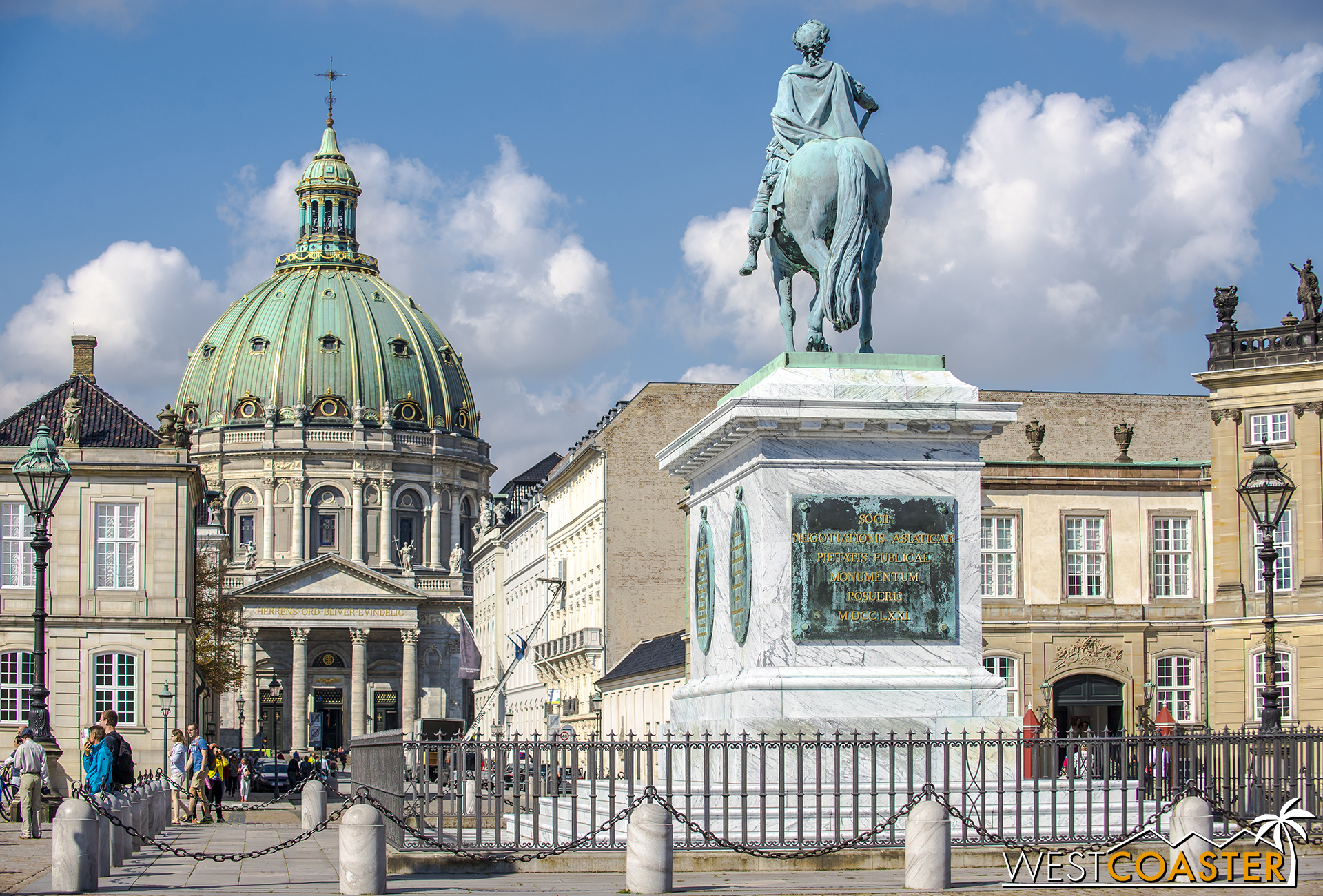 Amalienborg Plaza is the center of the Amalienborg Palace complex, home to the royal family. In this view, the towering Marble Church can also be seen in the background.