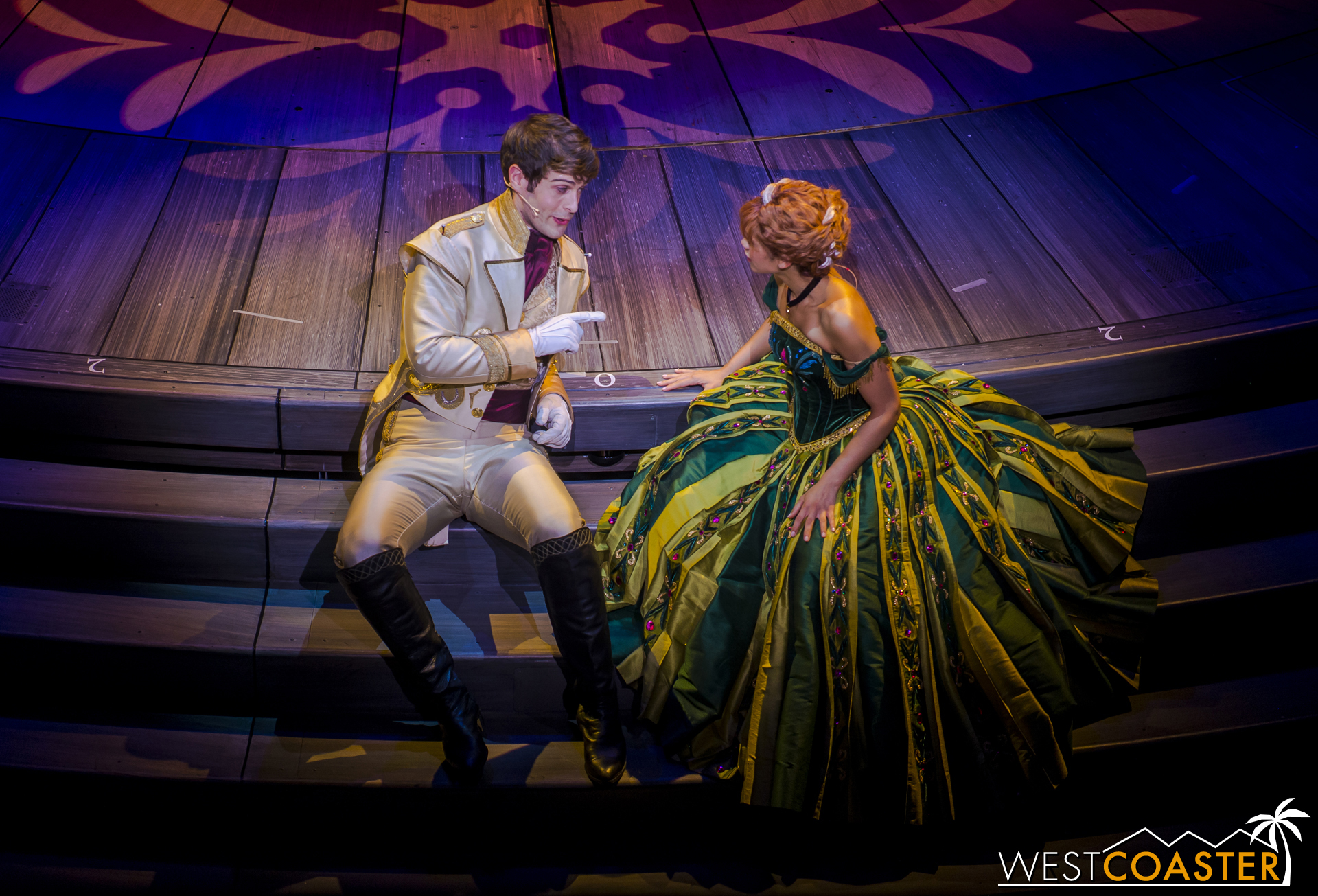 While Elsa isn't looking, Hans and Anna quietly discuss contingency plans in case the great dance does not sway Elsa.