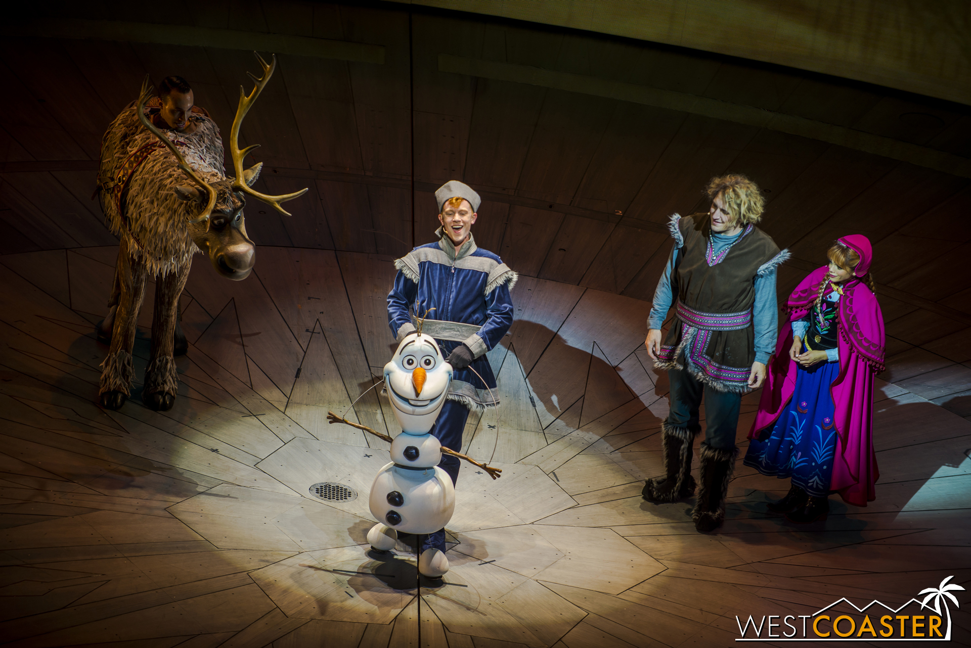 """Kristoff and Anna marvel at Olaf's powers, but the magical snowman simply explains, """"It's all in the warm hugs."""""""