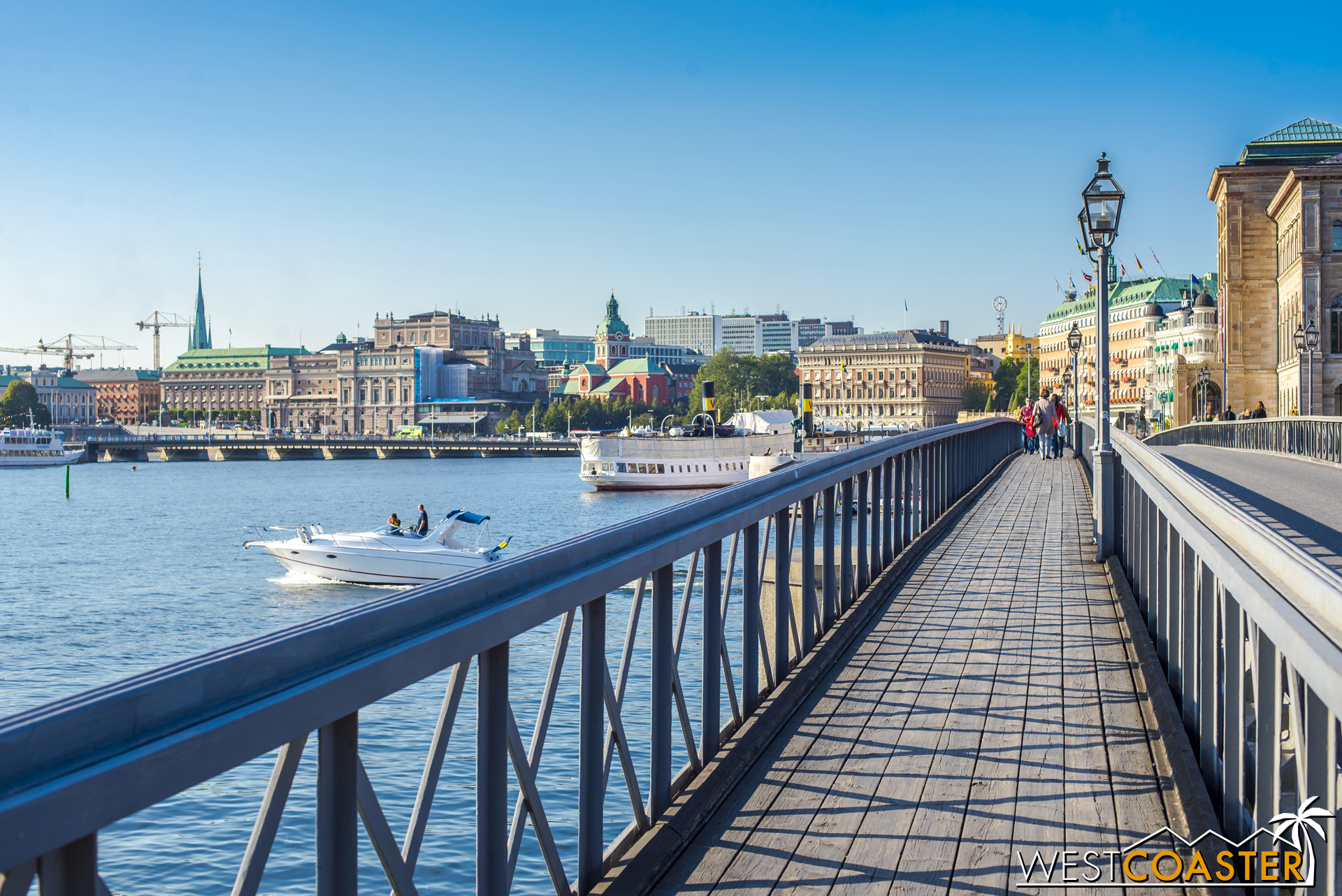 A stroll along the photogenic waterfront of Norrmalm by the Grand Hotel Stockholm features pricey properties and beautiful sights.