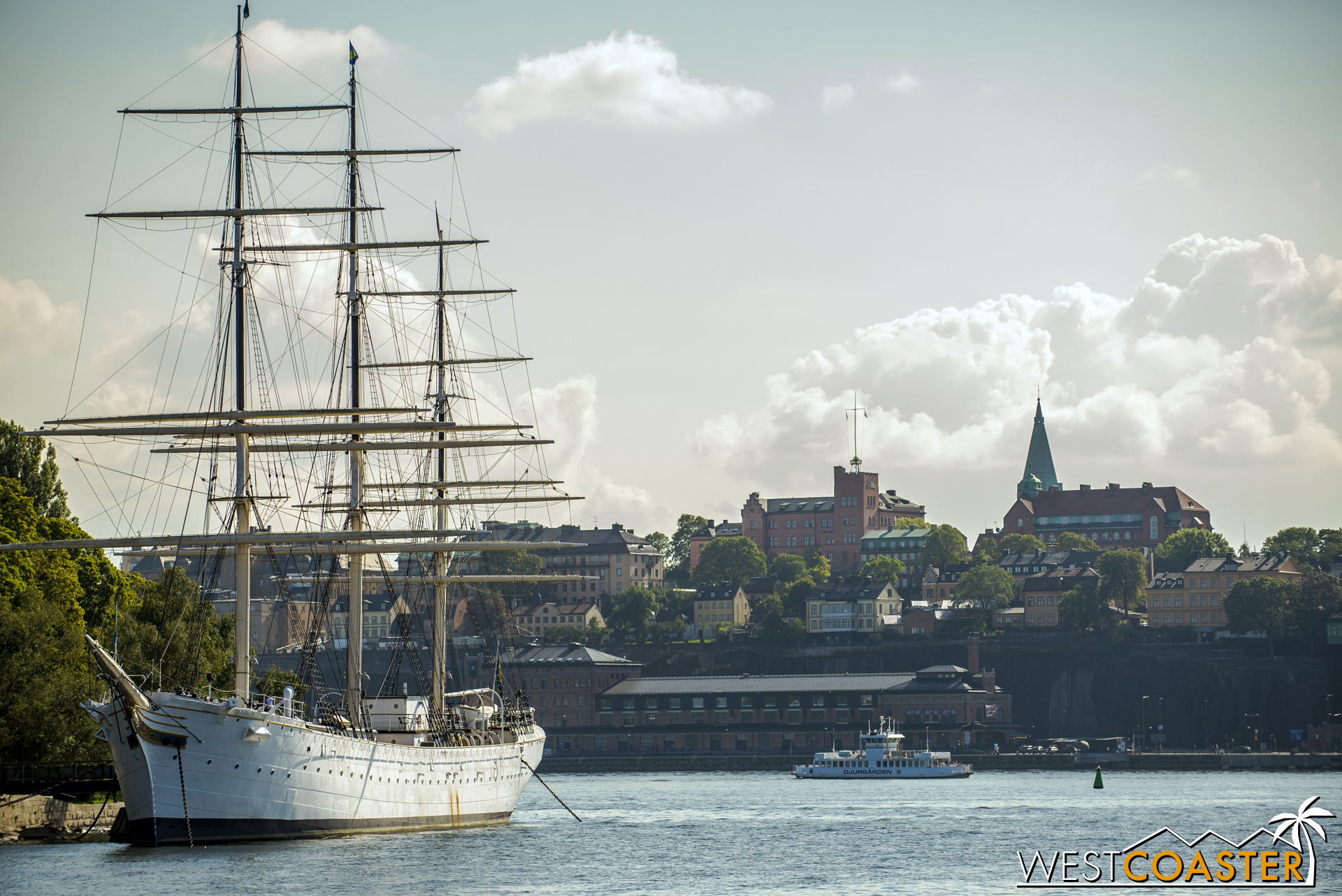 A ship is docked along the cost of Riddarholmen, with Sodermalm visible in the background.