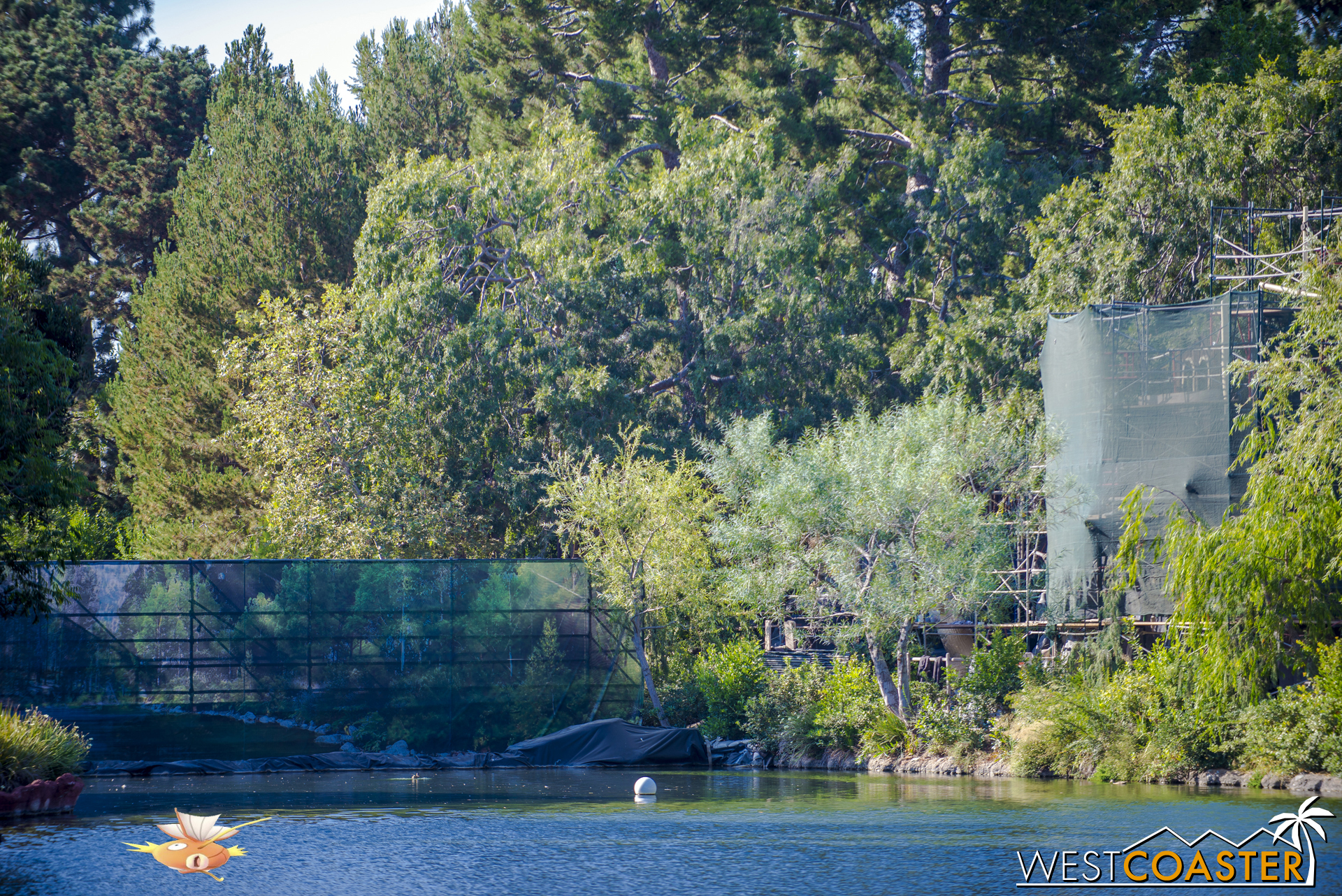 """The dam on the west side of the Rivers of America. As you can see from the """"Star Wars"""" Land construction photos, it is dirt immediately behind this tarp."""