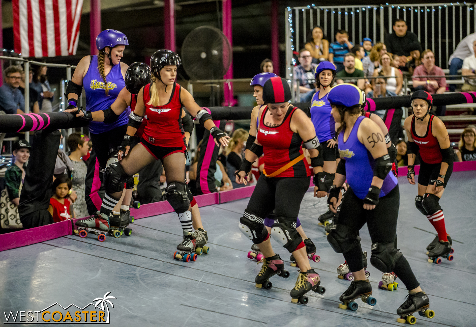 Blockers and jammers line up at the starting line of a jam.