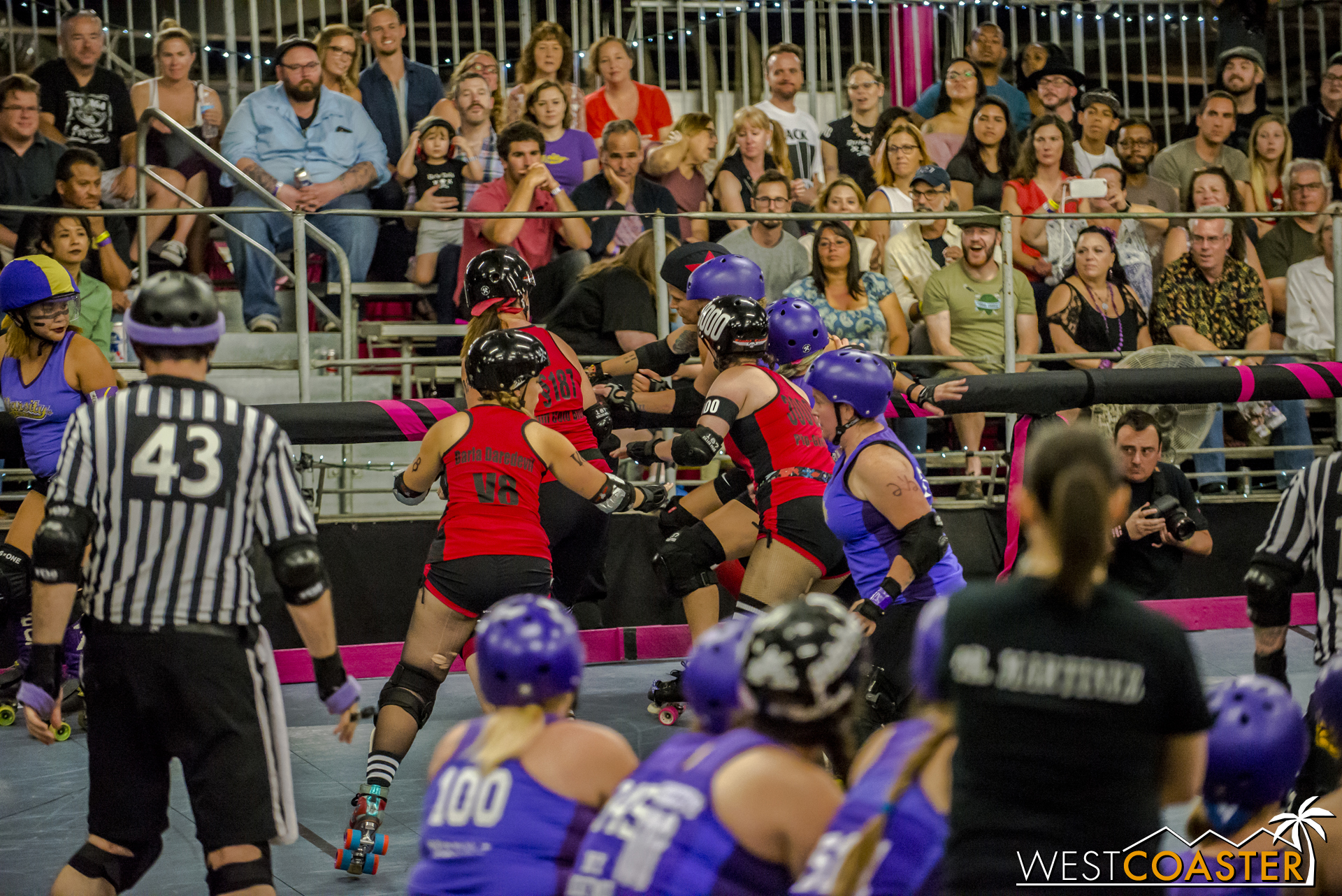 Fans watch as the ladies tussle around a turn.
