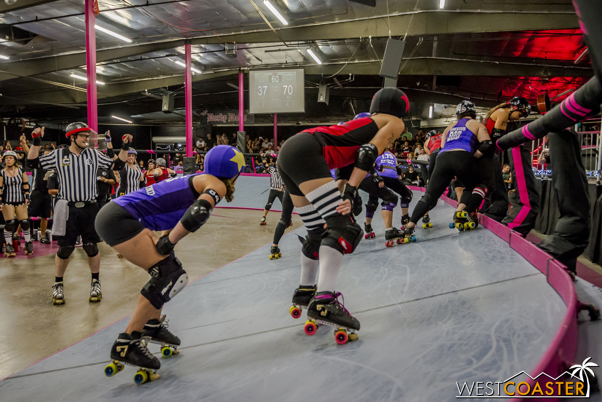 The jammers at the ready position, prepared to skate forth seconds after the blockers begin.