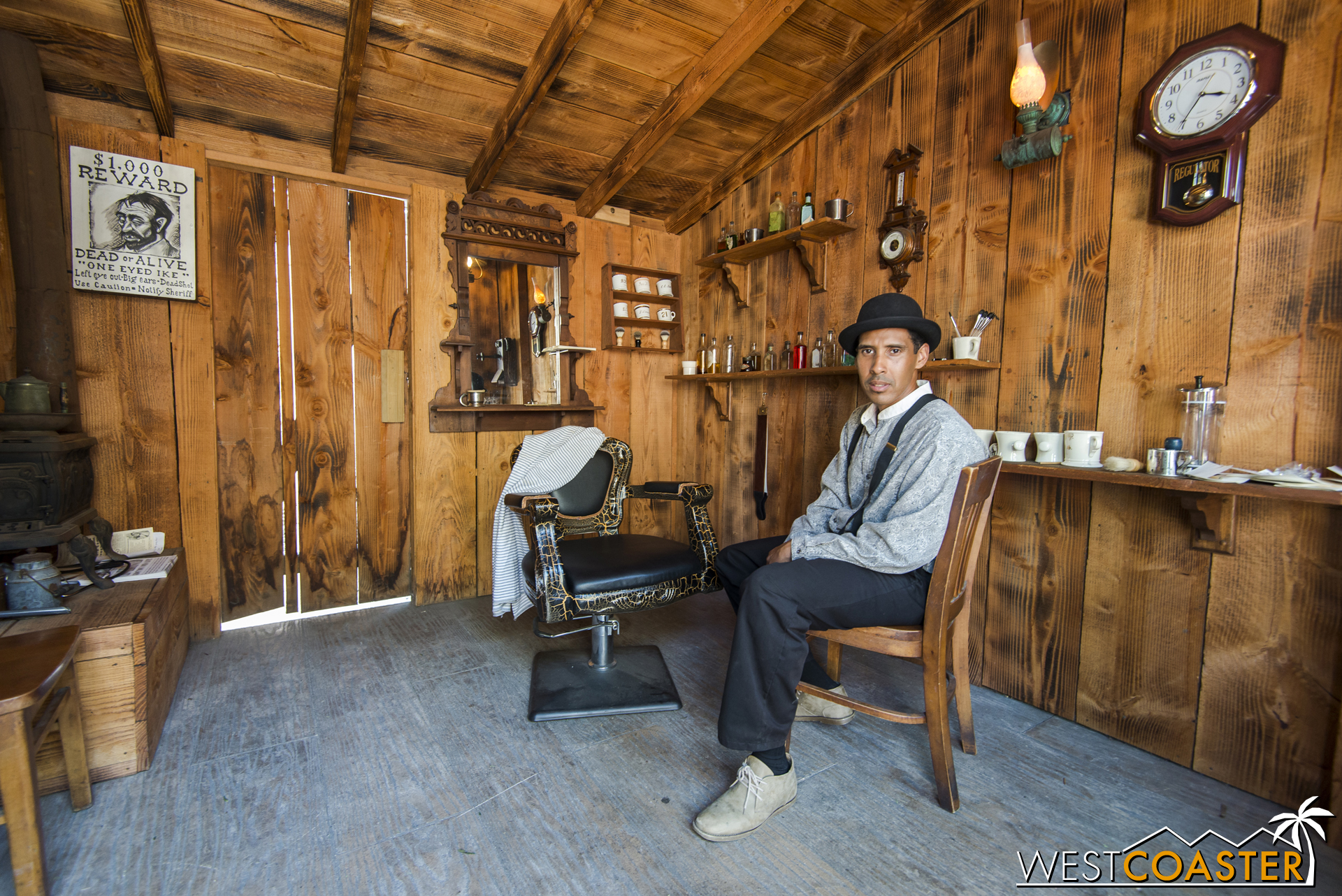 The barber of Calico, Mr. Percy Boyer, poses in his barbershop, one of the many peek-in's of Ghost Town opened up for Ghost Town Alive!