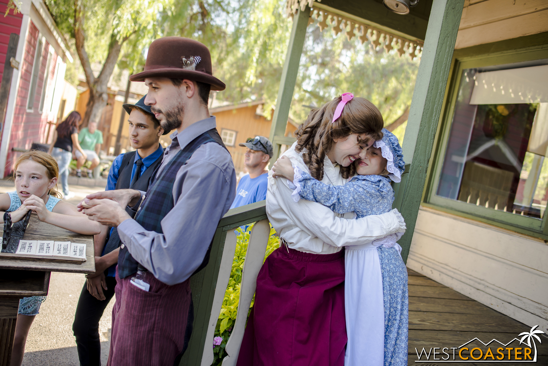 One of many beautiful moments at Ghost Town Alive!, Chelsea gives a young town citizen a hug.  For many kids, Ghost Town Alive! has been a magical experience of live theater, and they have returned on multiple occasions to engage in the production.