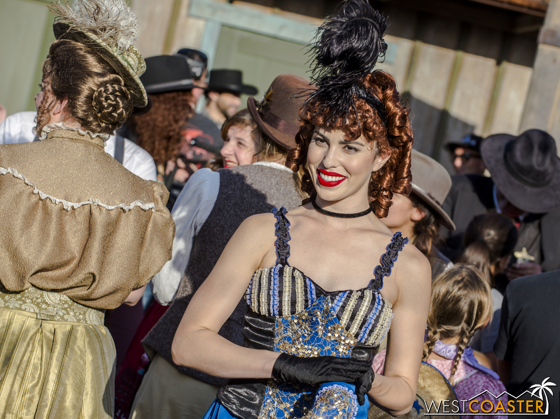 A Calico saloon girl looks on as the hoedown continues.