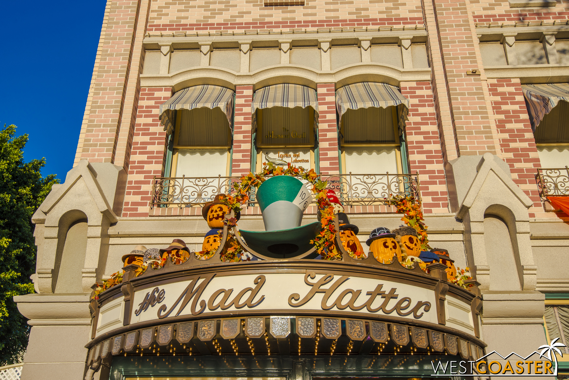 Smaller jack-o-lanterns dot the storefronts of Main Street.