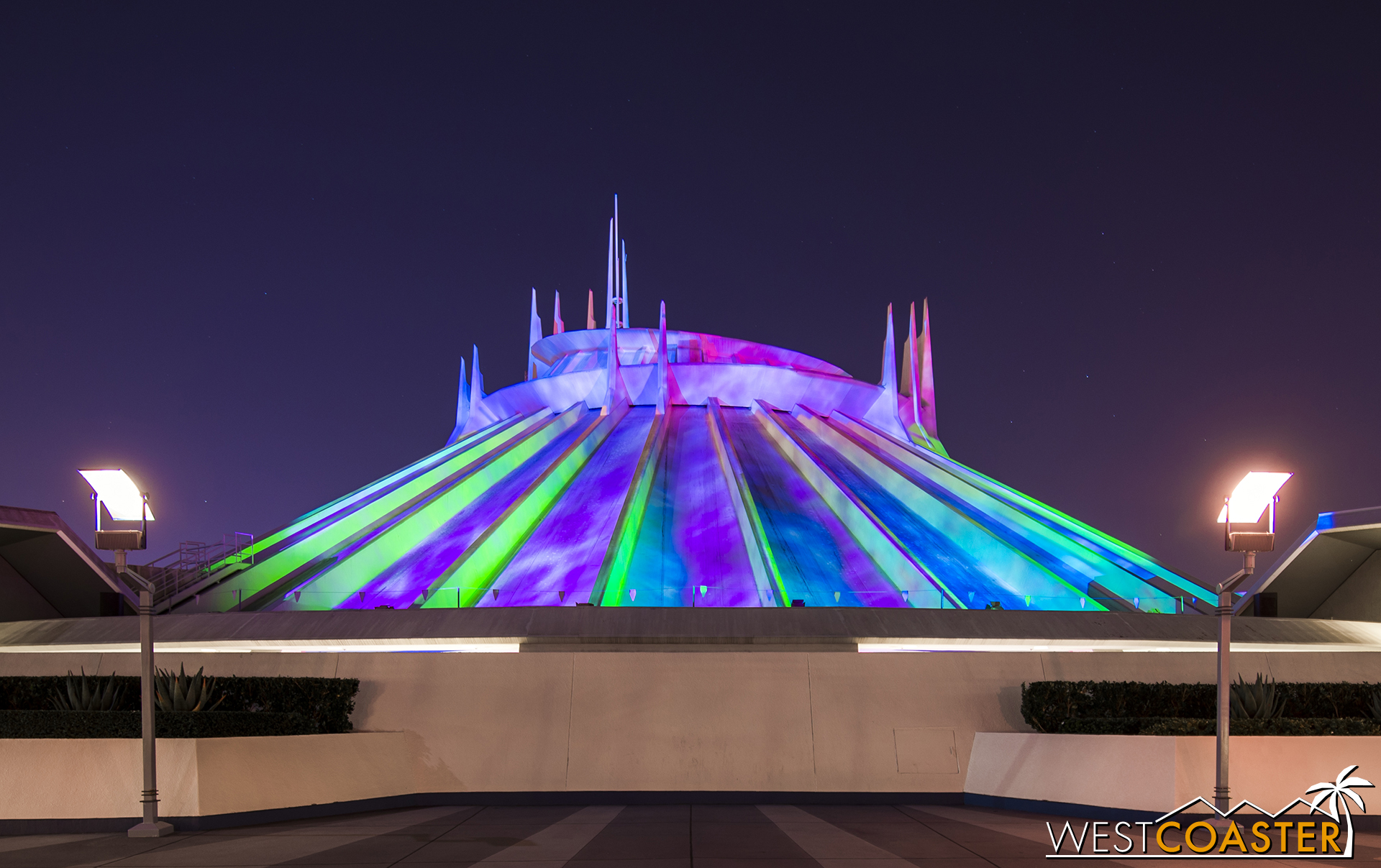 Space Mountain: Ghost Galaxy at night.