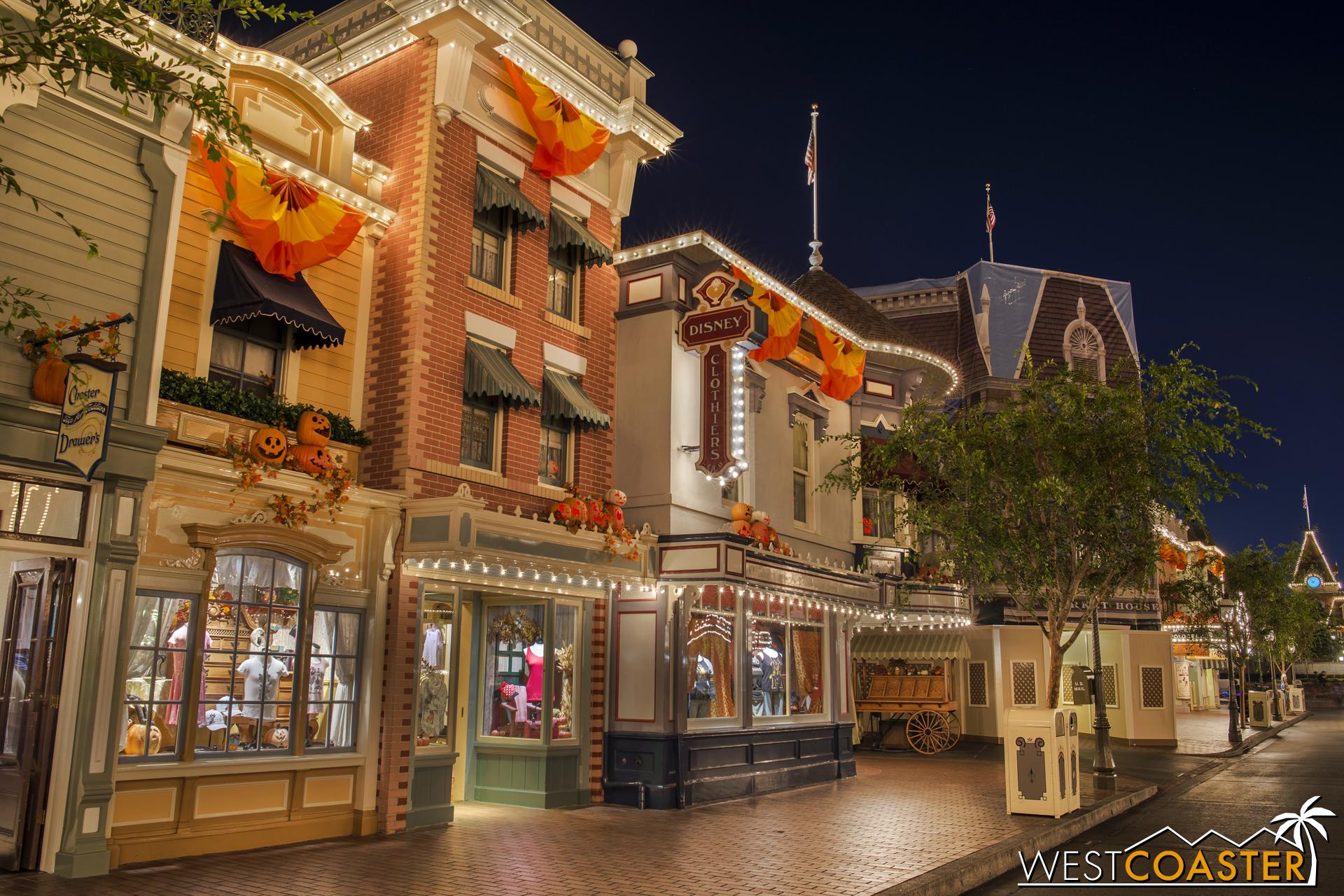 Disney Clothiers, with under-exterior-refurbishment Market House beyond.