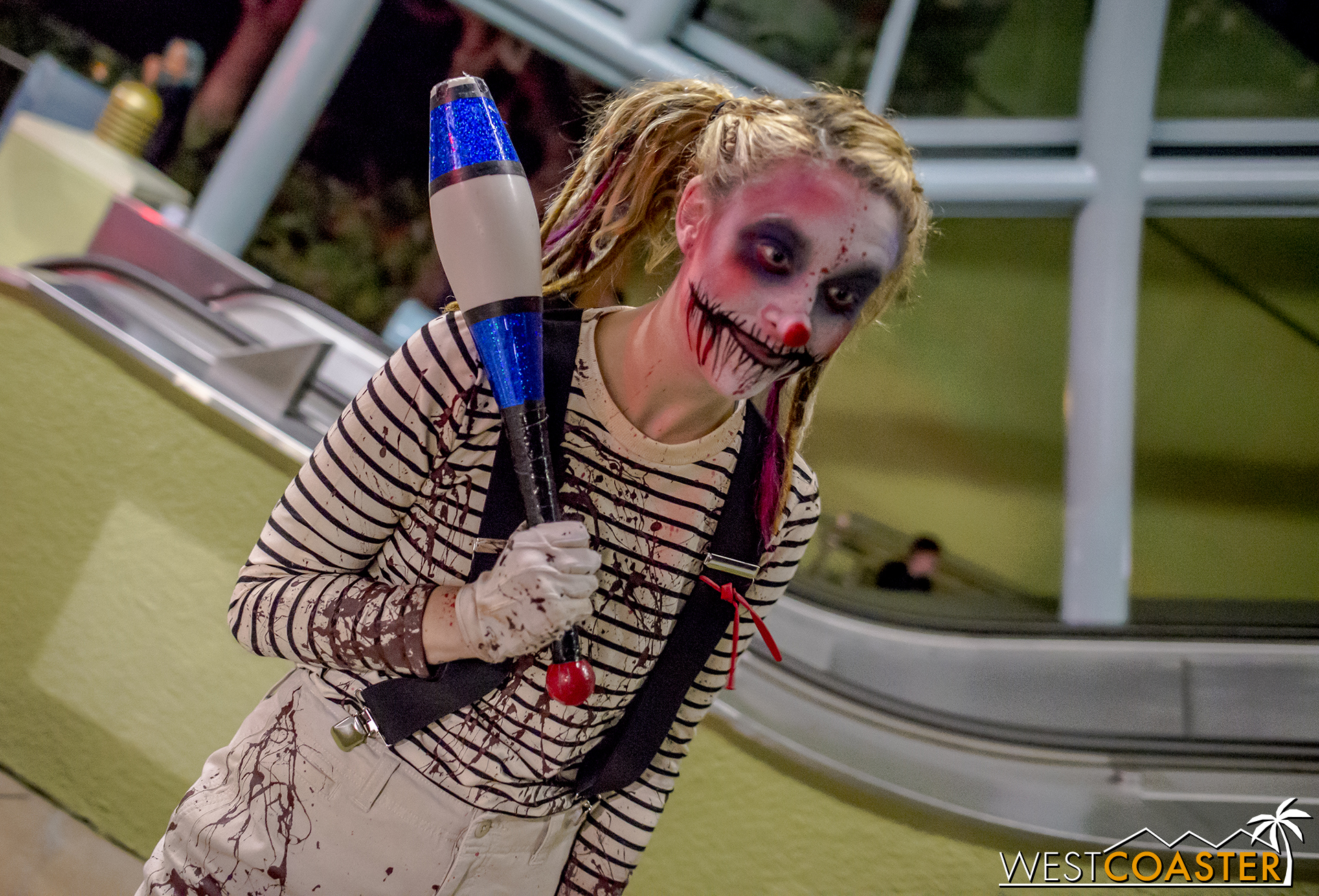 Guests coming down the escalator and getting into the Terror Tram line are greeted by roaming clowns as a taste for what's to come.