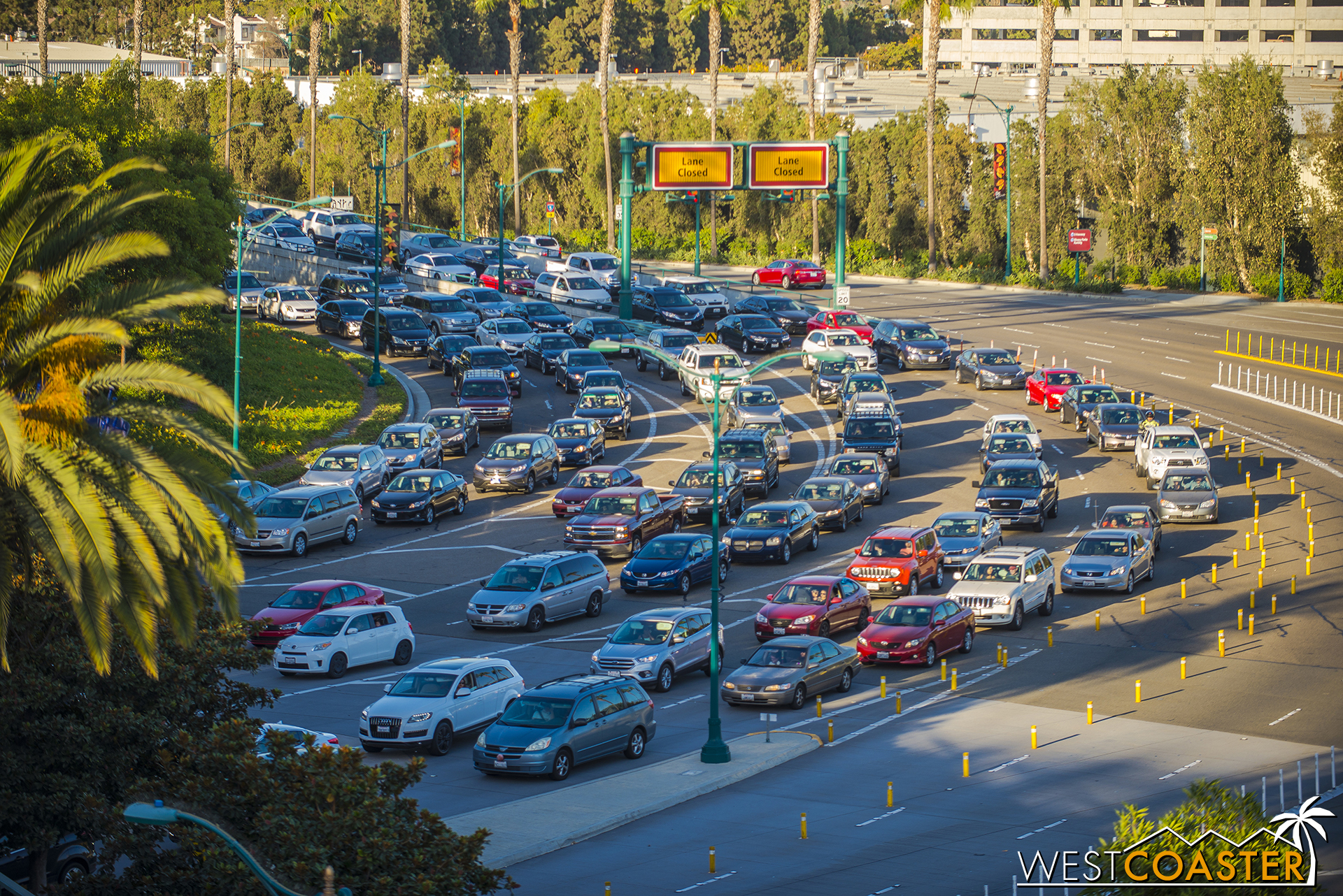 Remember when I said get to the parks early for Mickey's Halloween Party?  This is why.  At 4:00pm of Friday, the parking structure was backed up out of the structure.  An hour later, it looked like this, with cars backed up past Ball Road and over the express bridge as well.