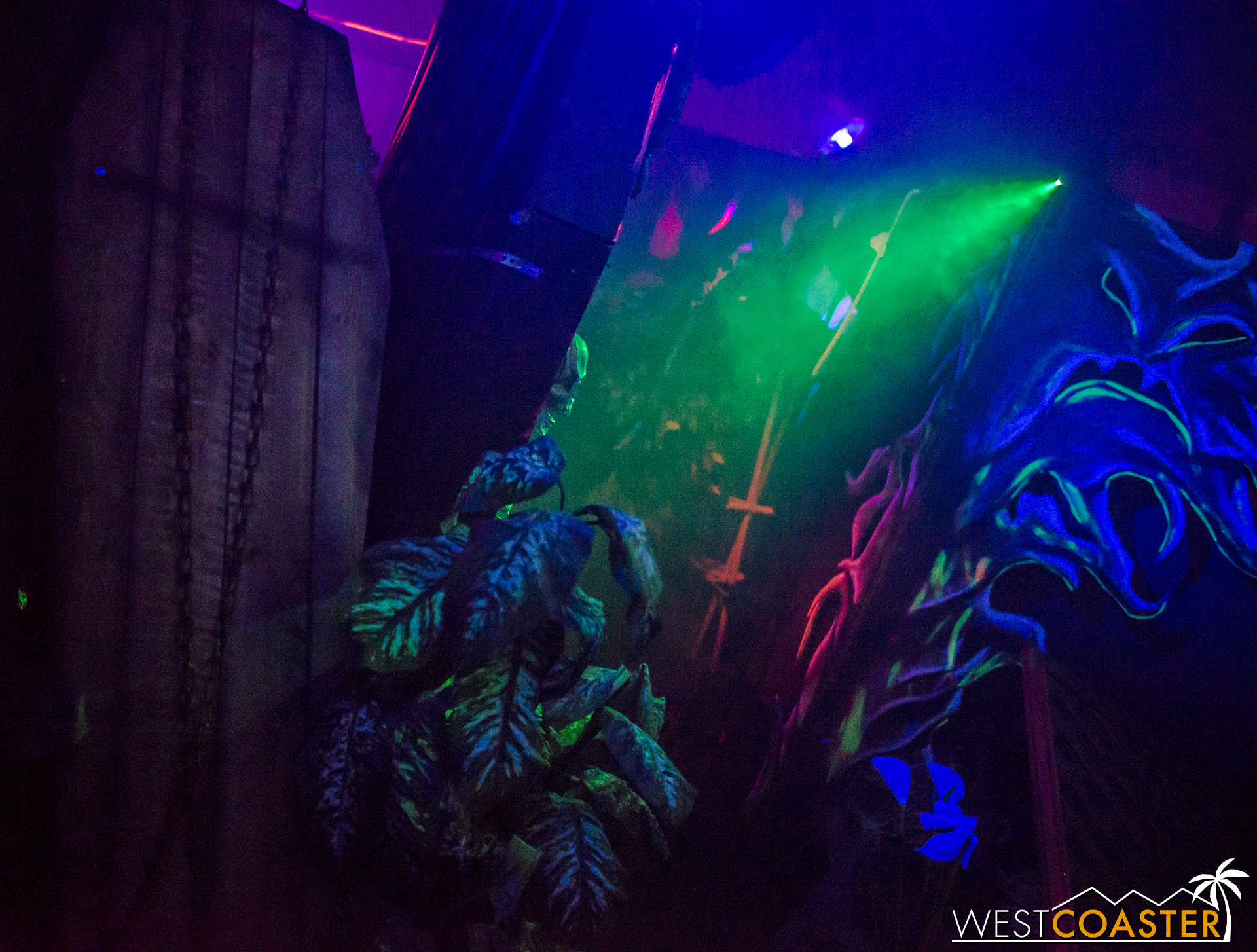 Black light and glowing paint are heavily employed.