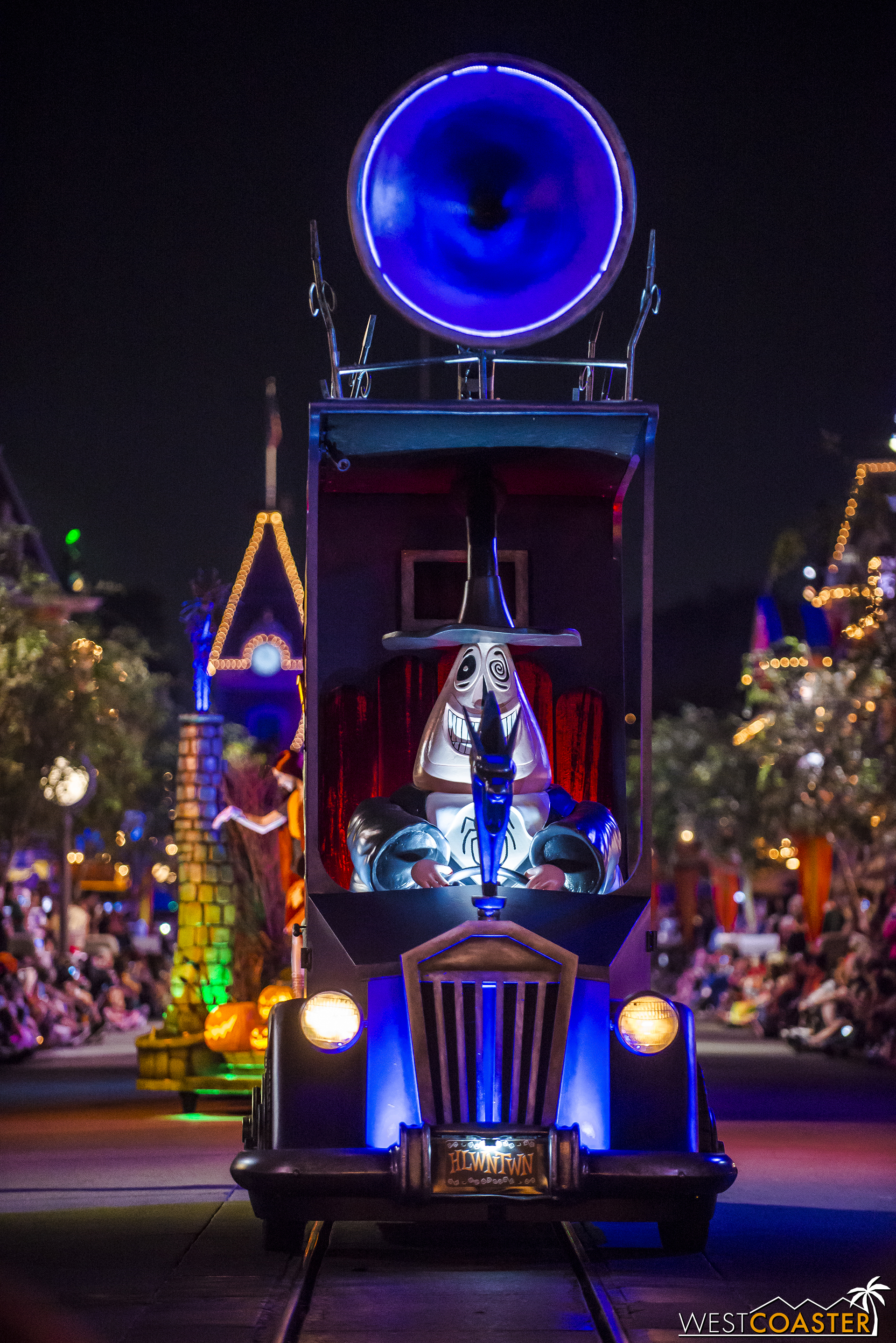 The Mayor of Halloween Town drives his vehicle up Main Street.