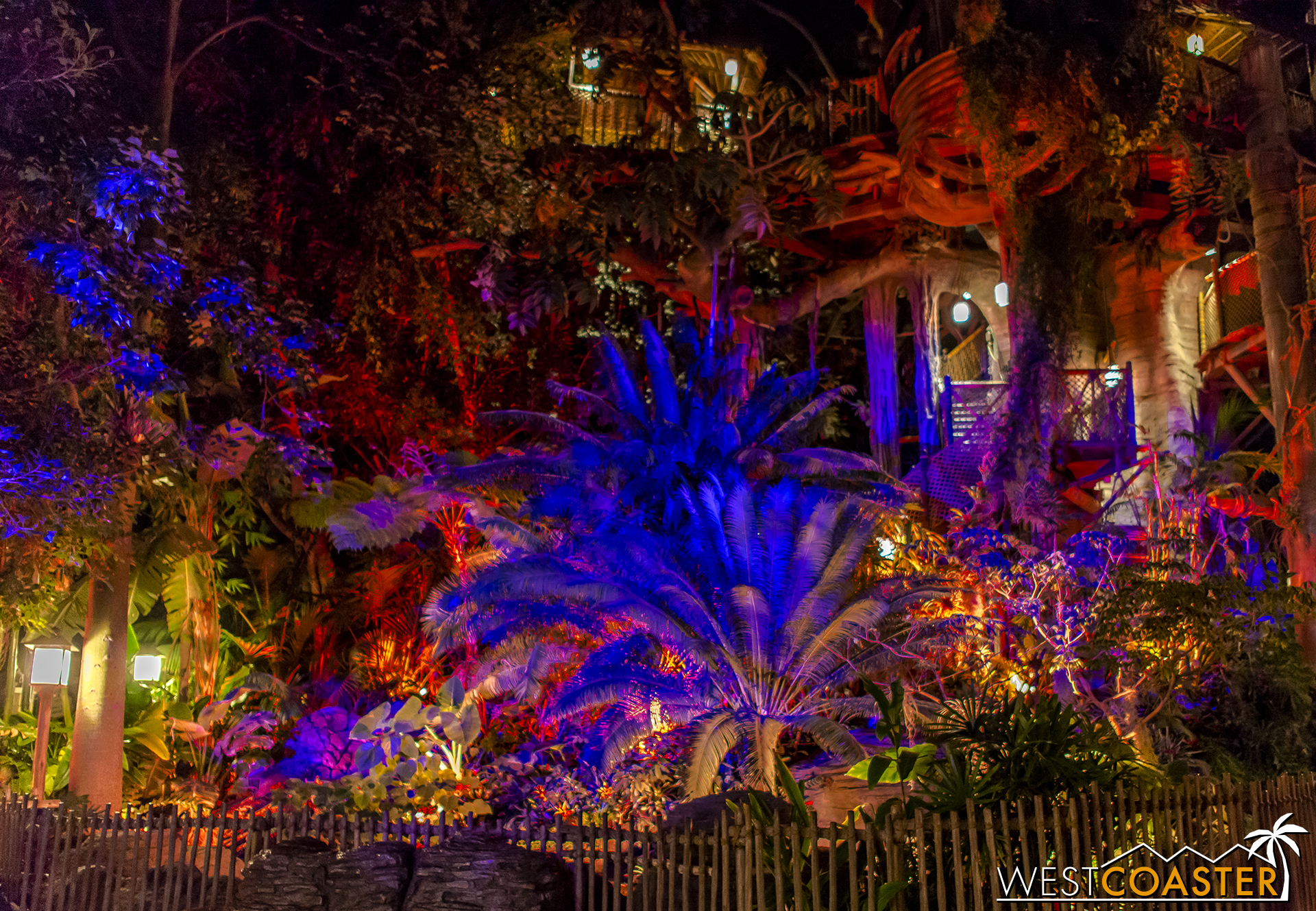At Tarzan's Treehouse, a slow-cycling colored lighting show illuminate the foliage, accompanied by sporadic lightning and ominous sound effects.
