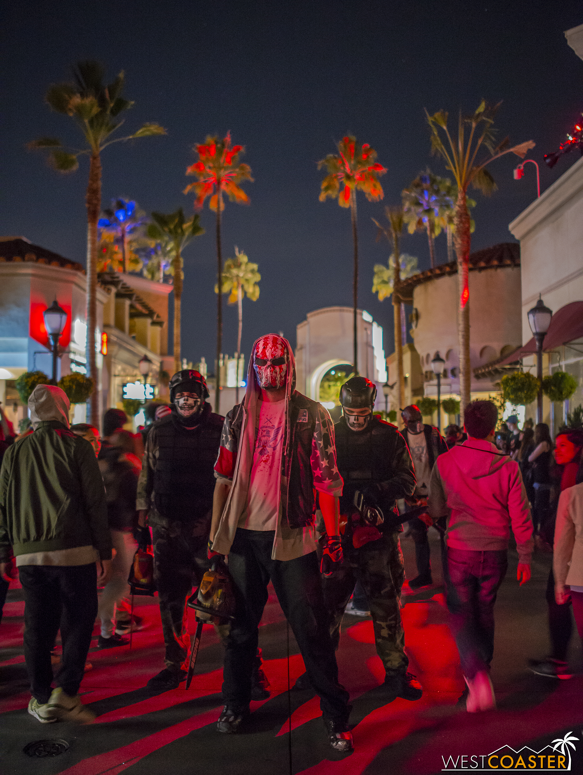 For those who've never been, during the last half hour of so, all the chainsaw scareactors from the park's street zones assemble at the main thoroughfare out of the park.