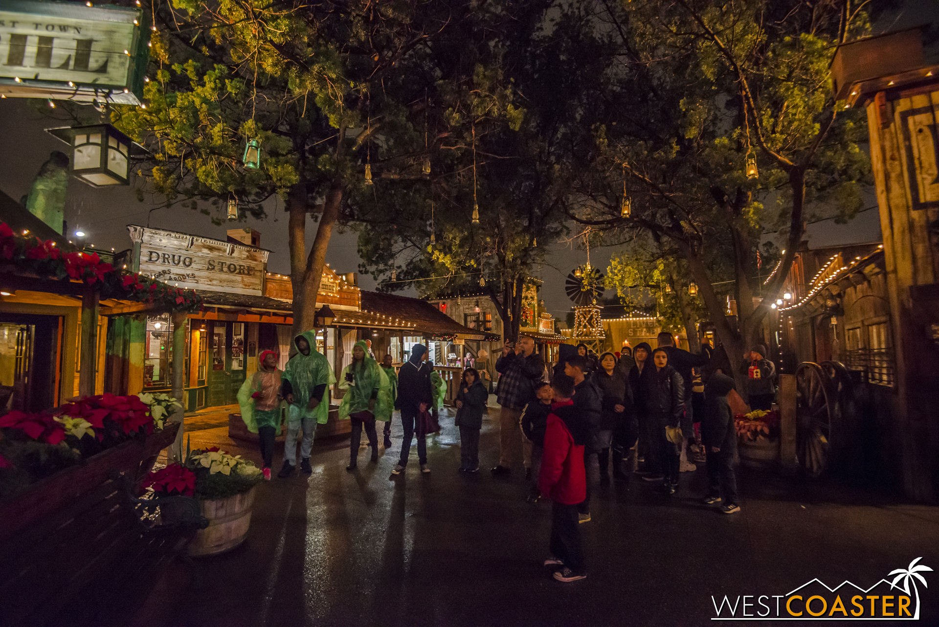 Guests gather in advance of the twice-nightly Snow and Glow moment in Ghost Town.