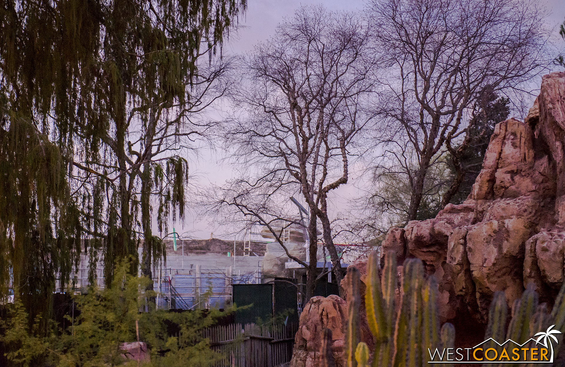 """The pathway between Frontierland and Fantasyland had been open during the Christmas and New Year's holiday period to alleviate the incredibly congested crowds and remove the double dead end in each area. And there were photos of videos eagerly showing off """"glimpses of 'Star Wars' Land"""" posted by people walking through with cameras above the (admittedly surprisingly low) temporary work walls. But those were really just photos of the rockwork that will face Frontierland and shield the actual """"Star Wars"""" Land from guests passing through the western-themed area of the park. So sorry guys... that wasn't """"Star Wars"""" Land at all."""