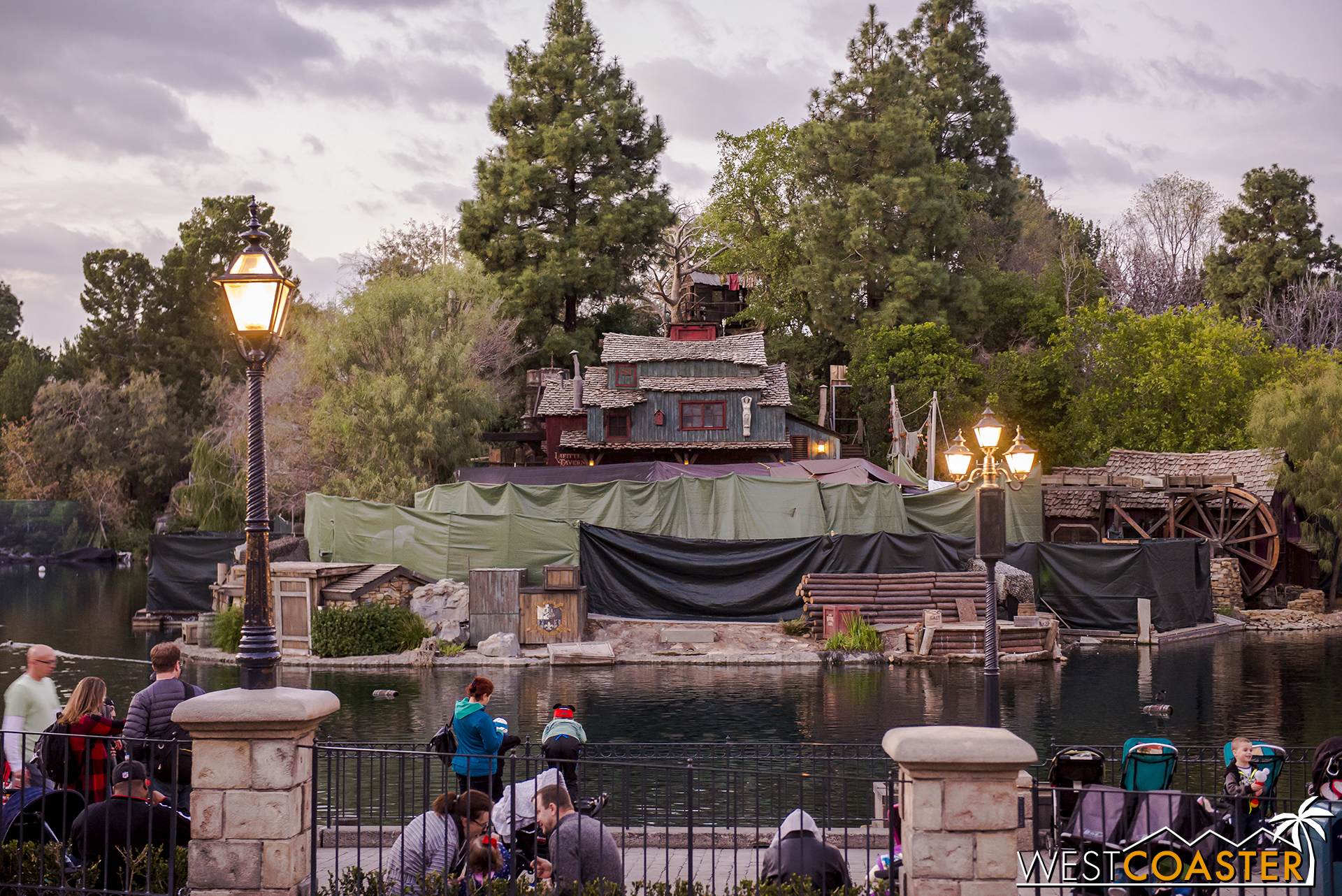 Curiously, tarps are up around the front of Tom Sawyer's Island now, even though they weren't when the building facades were being painted.