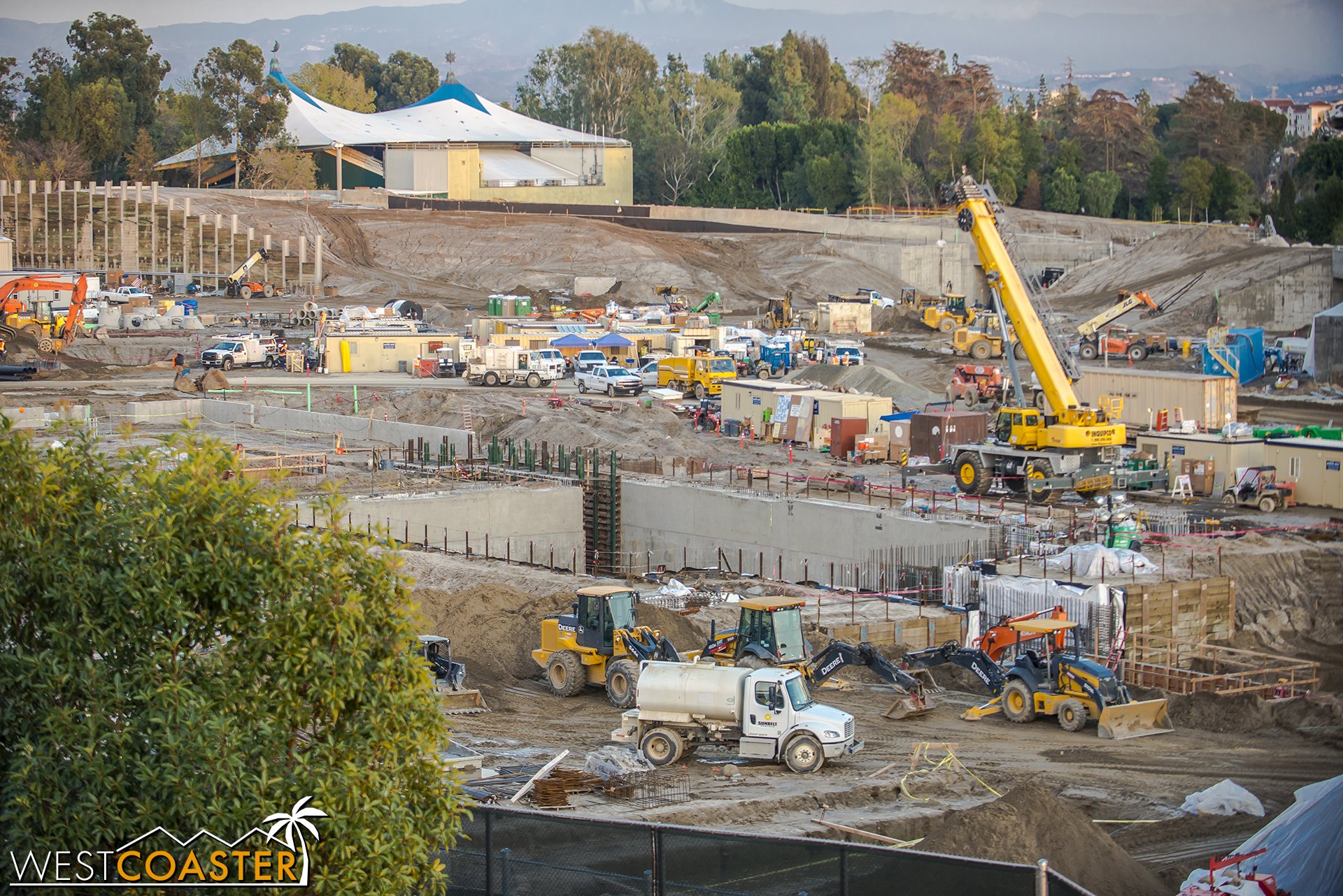 Here, we can see that giant pit that they've been digging with concrete retaining walls.