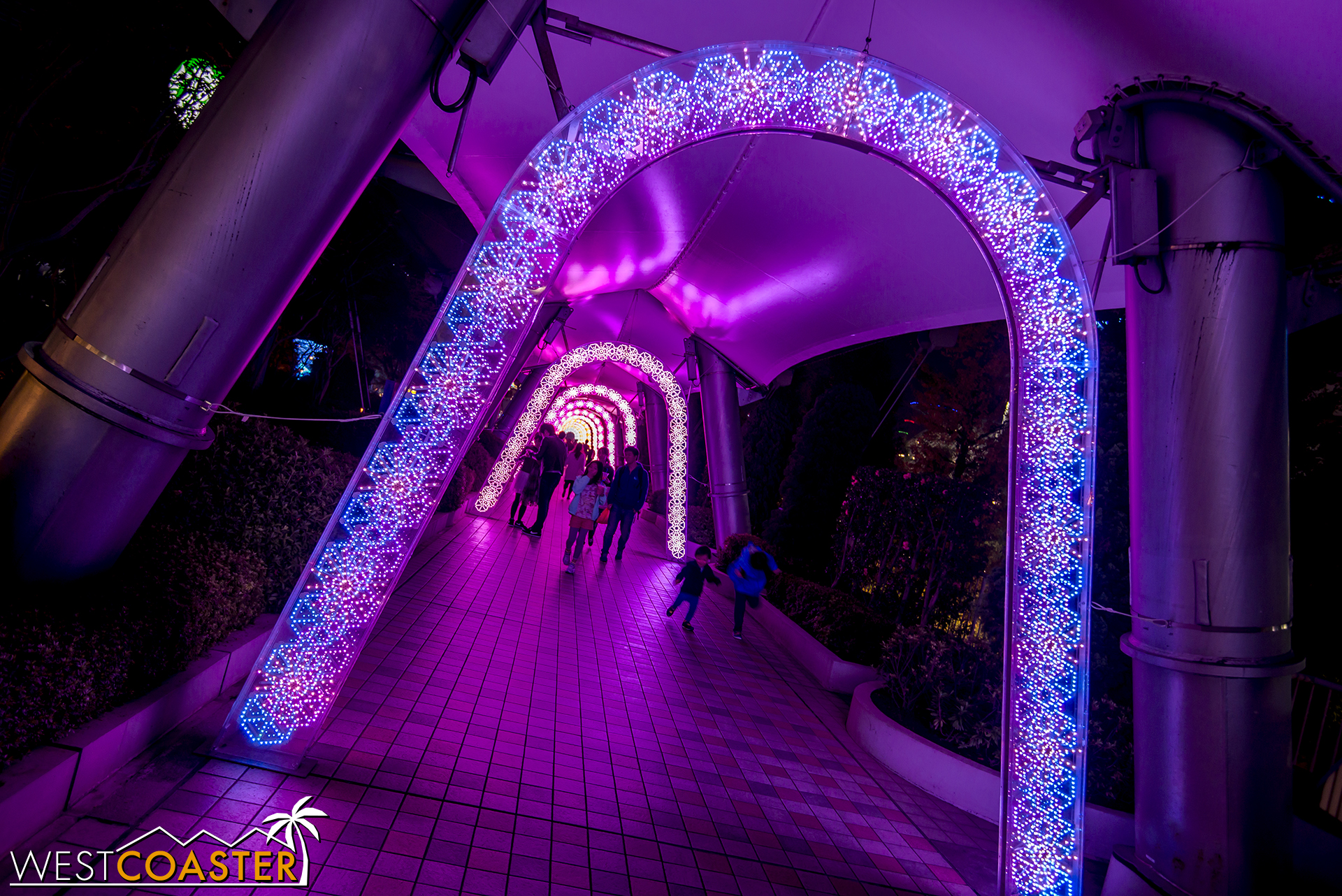 Colorfully light archways illuminate the pedestrian paths during the holidays.