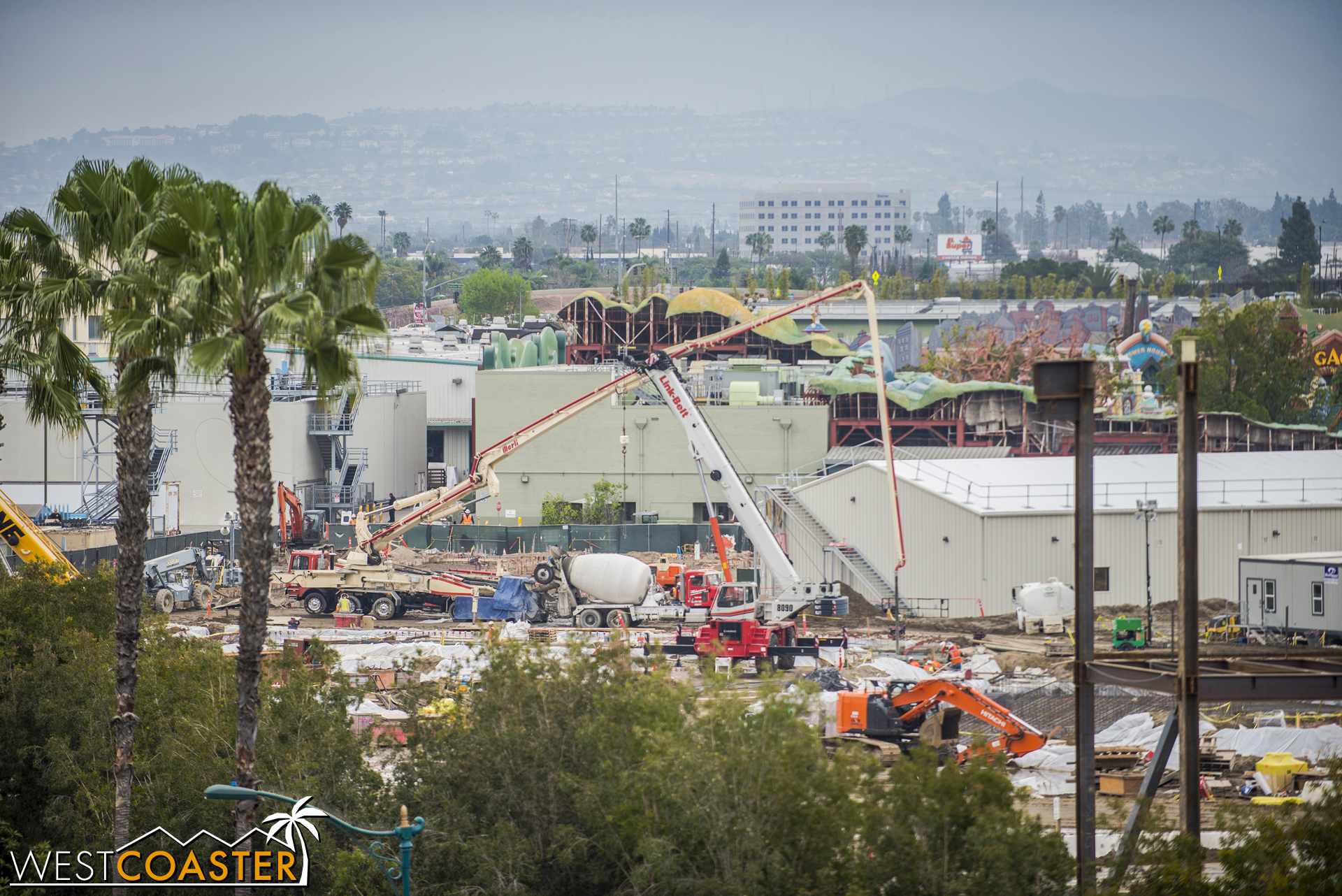Over in the back corner, near Mickey's Toontown, concrete trucks appear to be pouring concrete for another building.