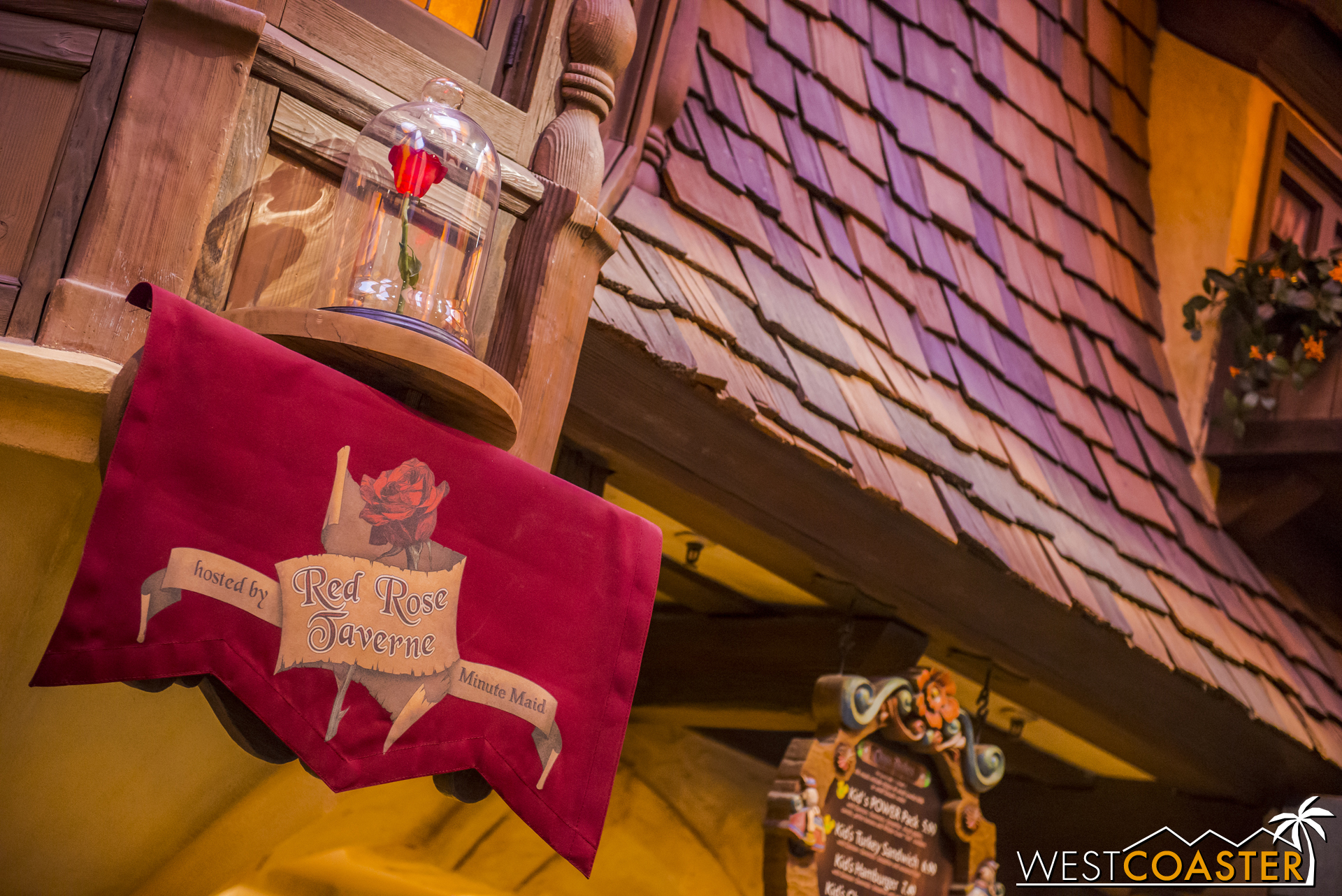 The Beast's red rose occupies the shelf where Pinocchio normally sits.