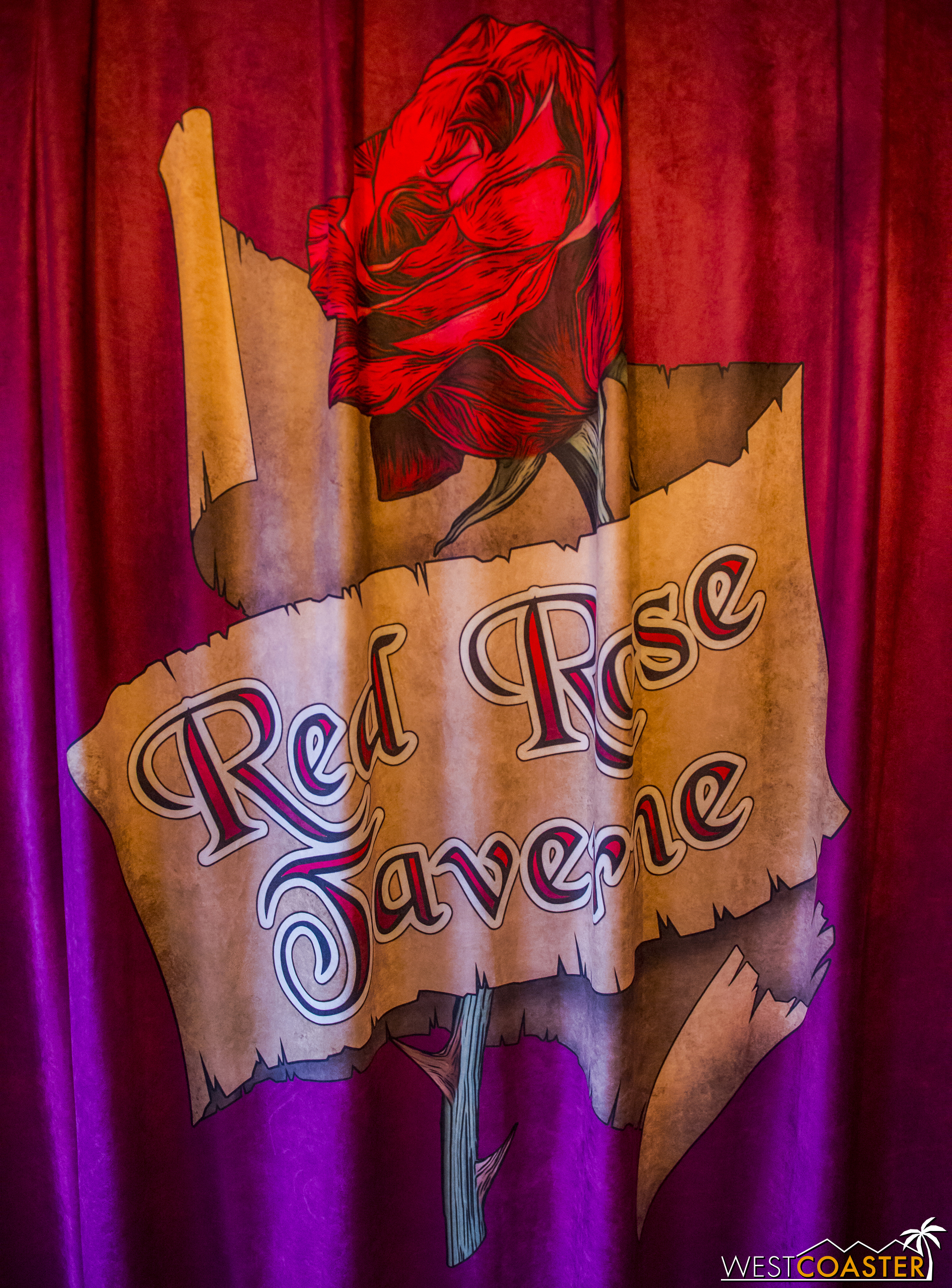 Entering the building, curtains with the Red Rose Taverne logo drape both sides, covering up the regular Pinocchio murals.
