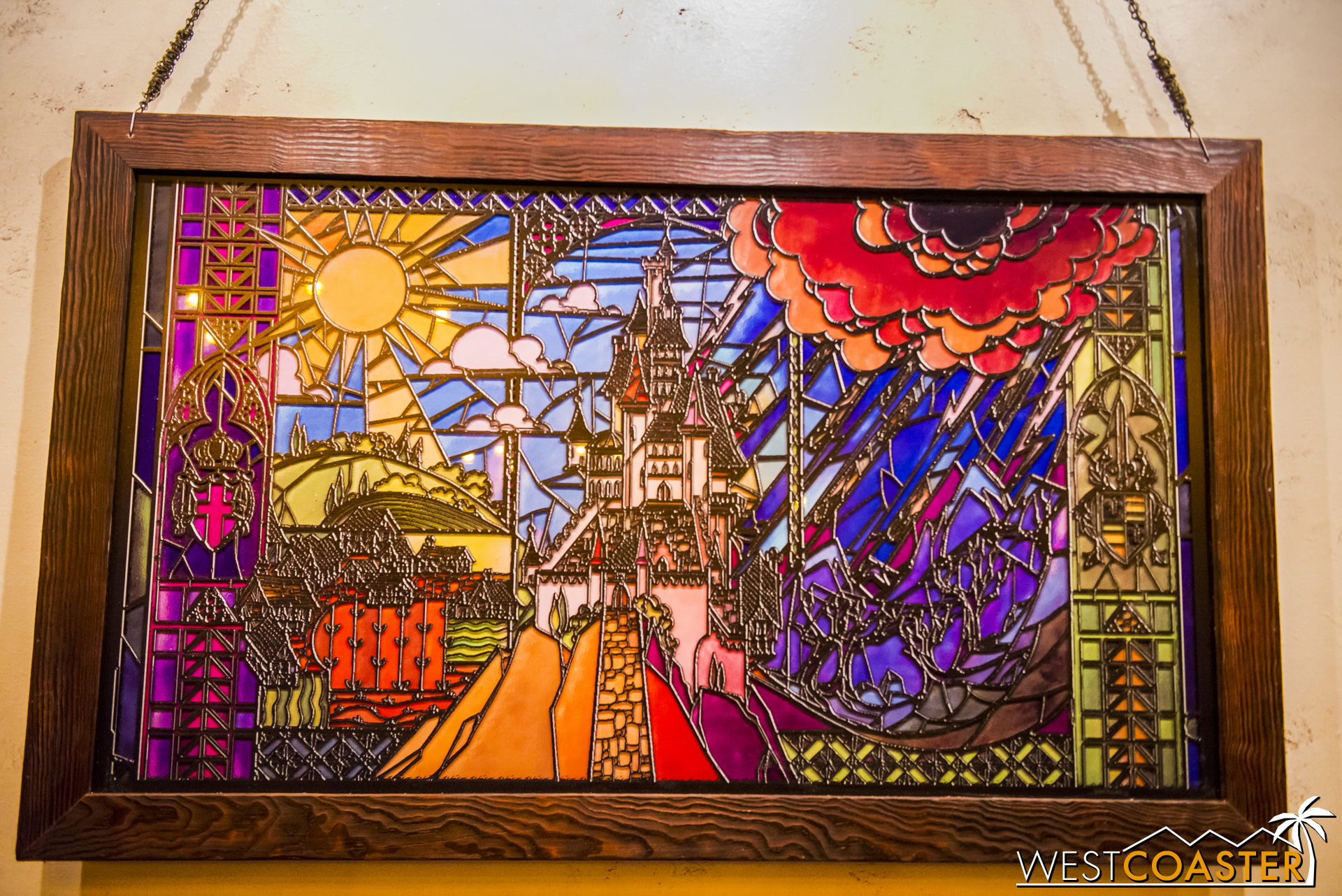 This lovely stained glass piece is on the wall opposite from Gaston's portrait and is gorgeous.
