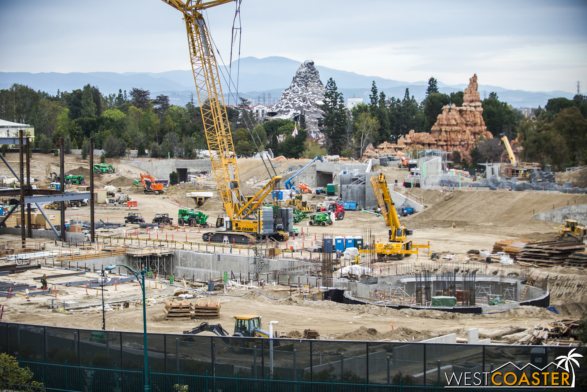 """Concrete work continues advance at the """"trench"""" and """"pit' areas of the future E-Ticket."""