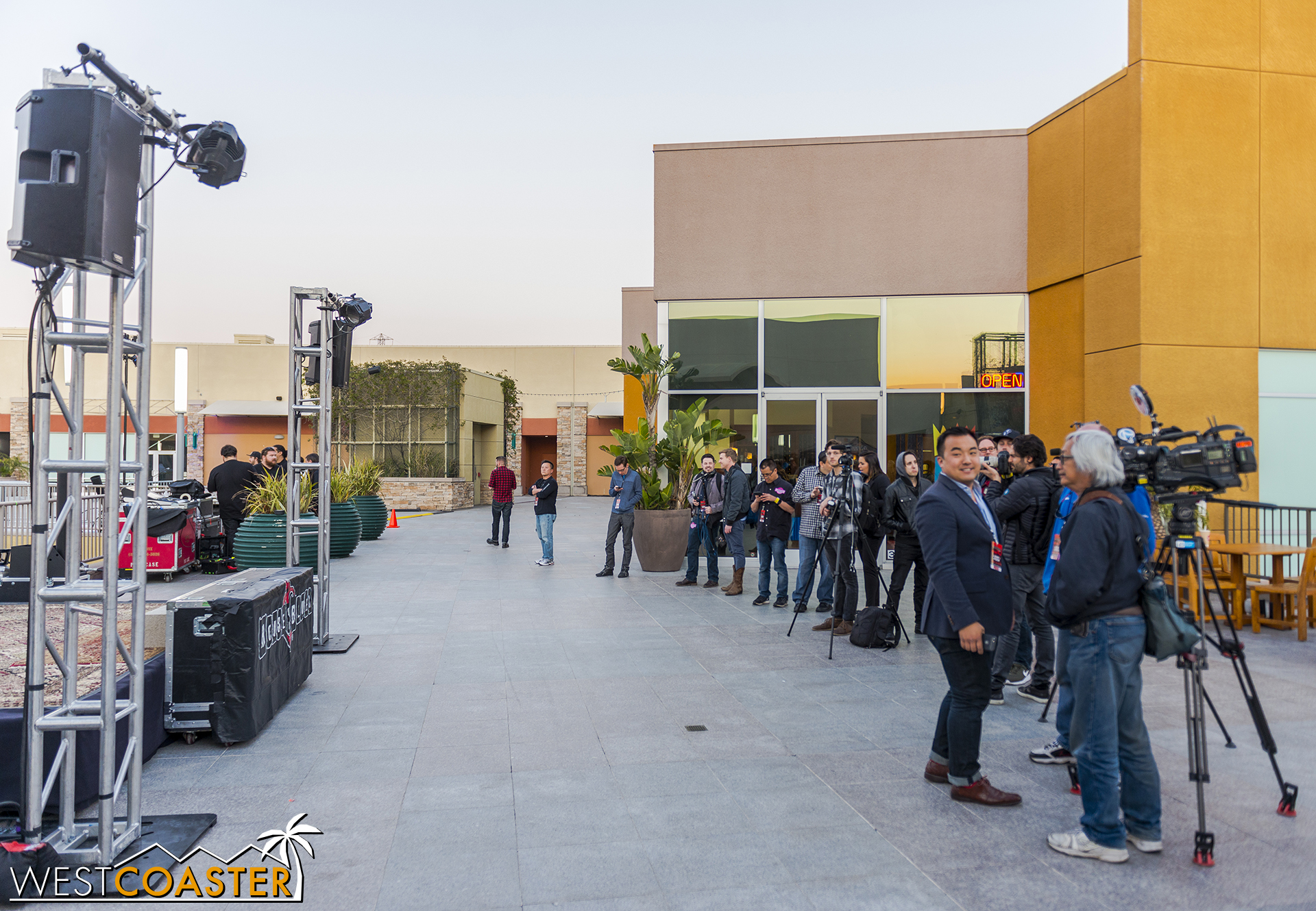 Media members waiting for the grand opening festivities.